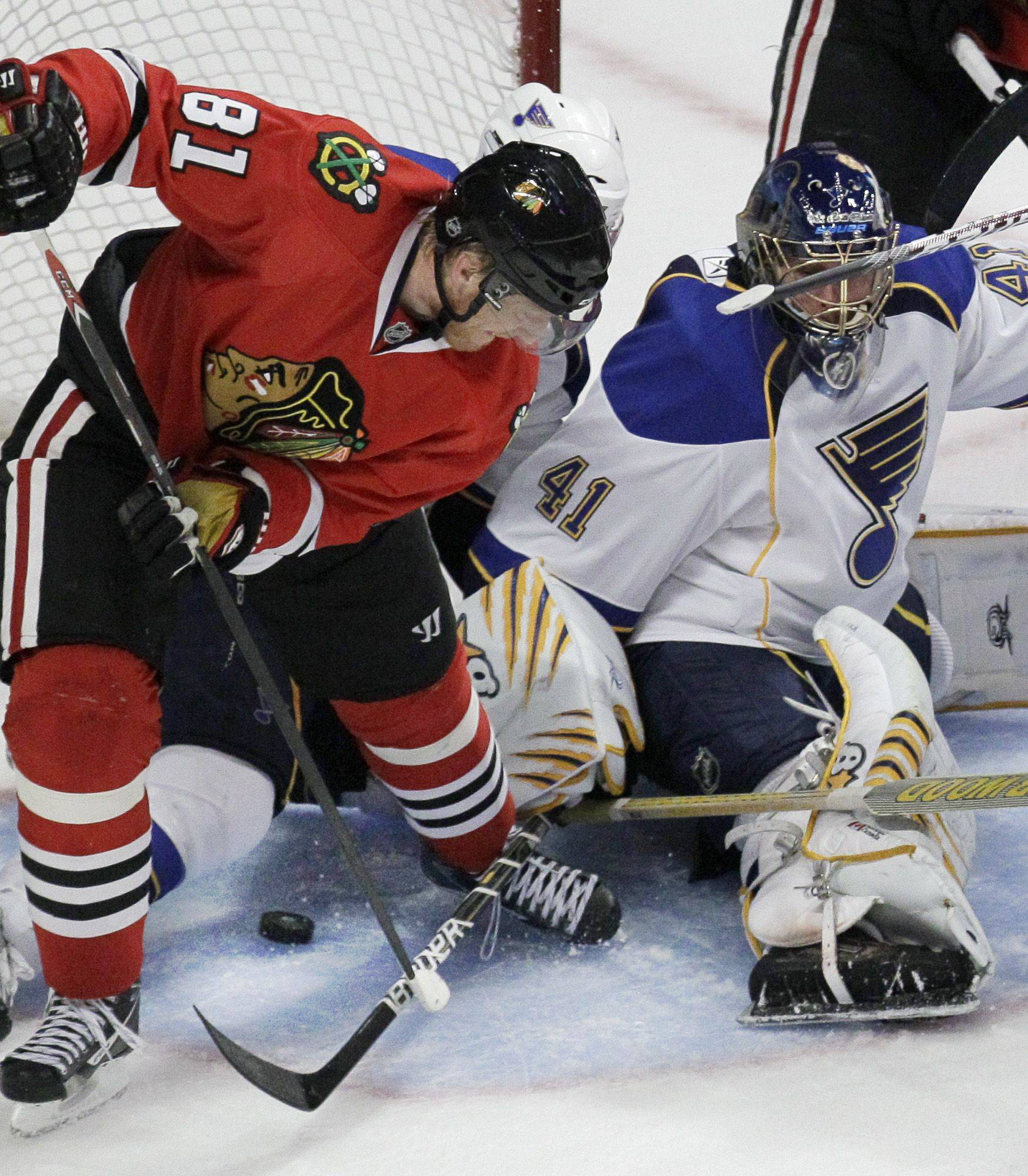 Marian Hossa slips the puck between his legs and past Blues goalie Jaroslav Halak to tie the game late in the third period Monday night at the United Center. It was Hossa's second goal of the game and his seventh of the season