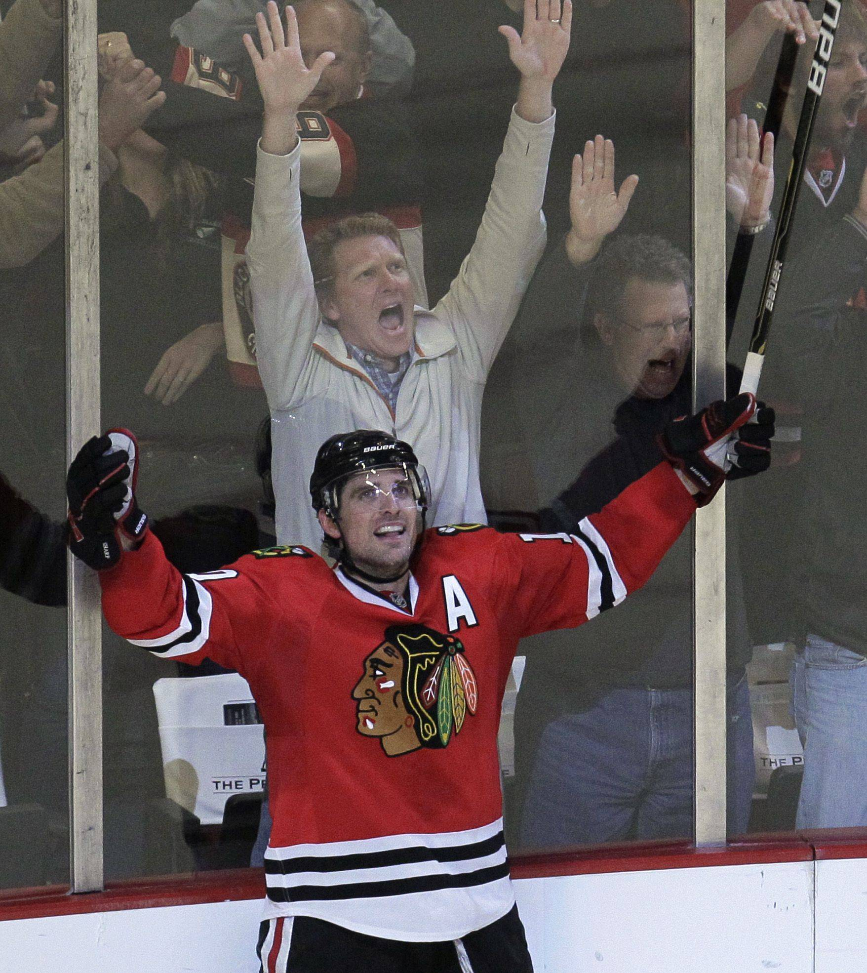 Patrick Sharp celebrates after his goal gave the Blackhawks an overtime victory over the Blues on Monday night.