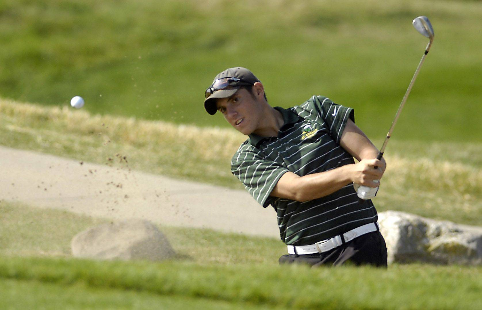Michael Holevas of St. Edwards chips out of the sand during the Westminster Christian Class 1A boys golf sectional at Golf Club of Illinois in Algonquin Monday.
