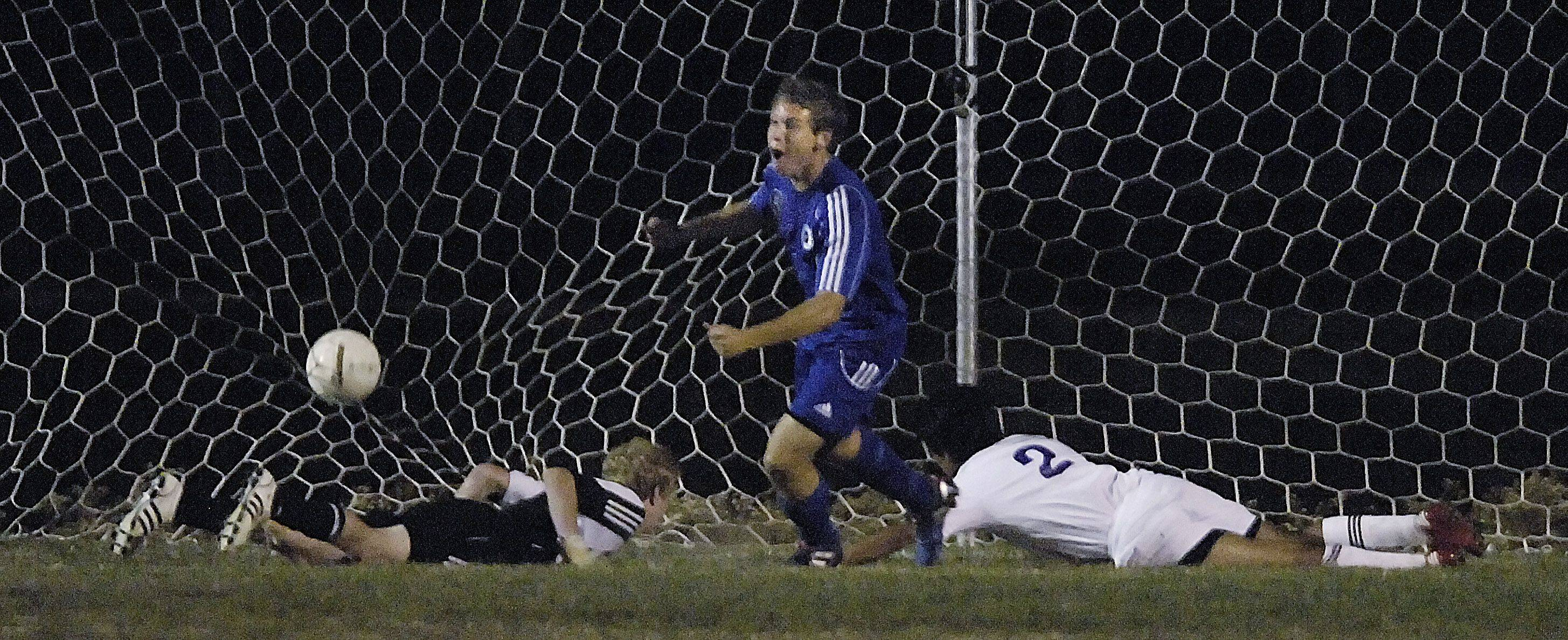 Burlington Central?s Christopher Gousios turns to his teammates as Hampshire goalkeeper Marcus Quick and midfielder Michael Gonzales lay on the turf following a goal Tuesday for the conference championship.