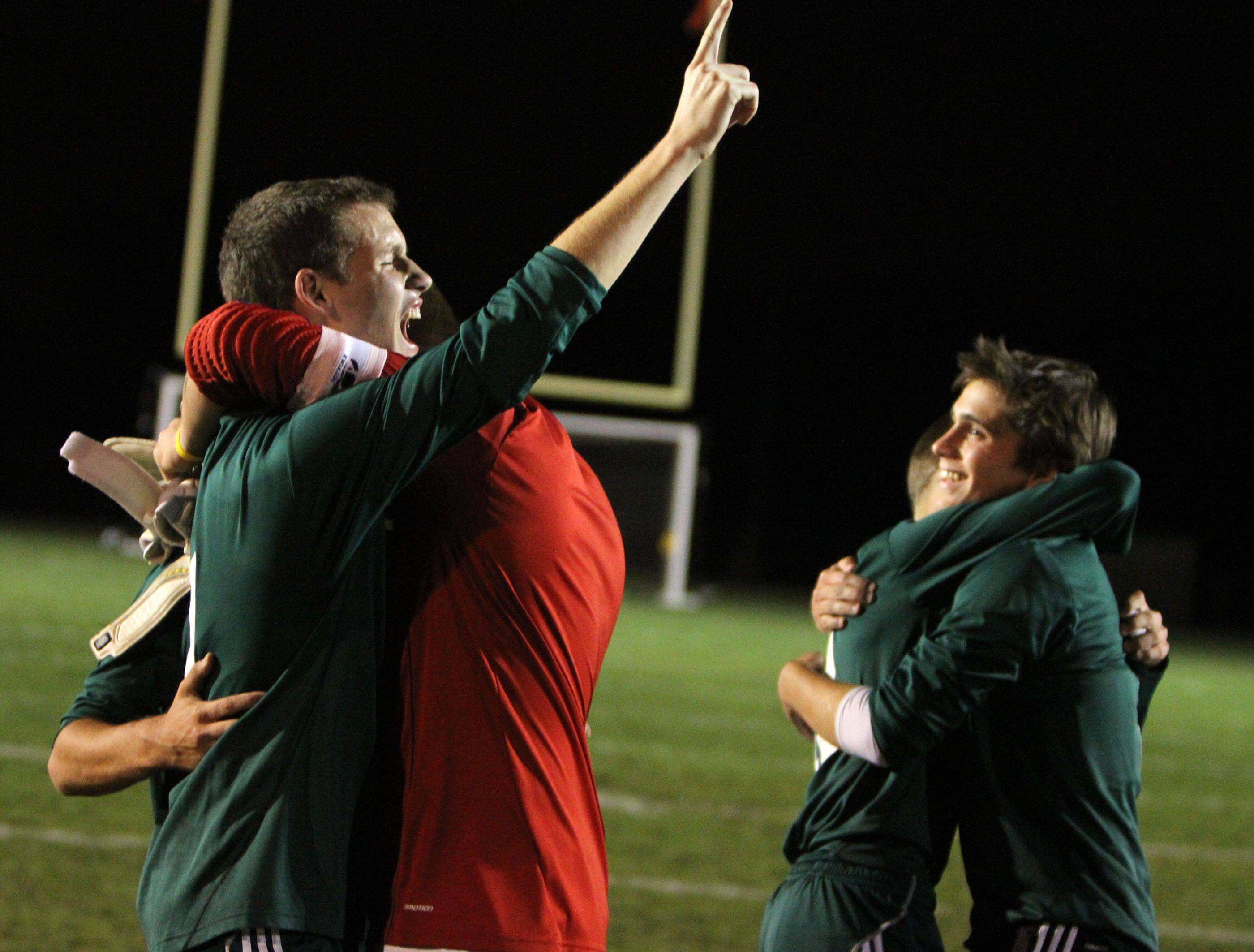 Fremd?s Alex Prelipceanu signals number one after his team defeated Elk Grove Thursday.