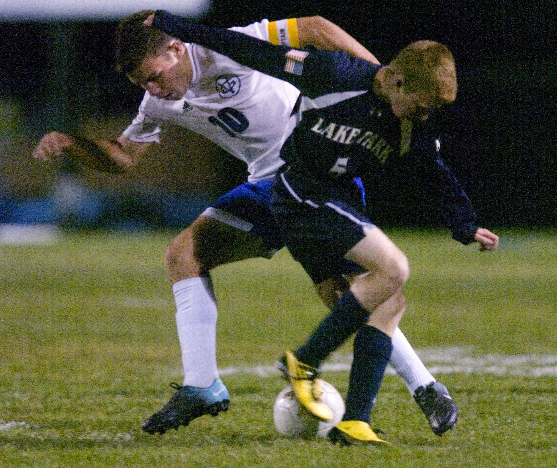 Cameron Siegle of Lake Park and Brady Wahl of Geneva rush for the ball during Thursday?s soccer match in Geneva.