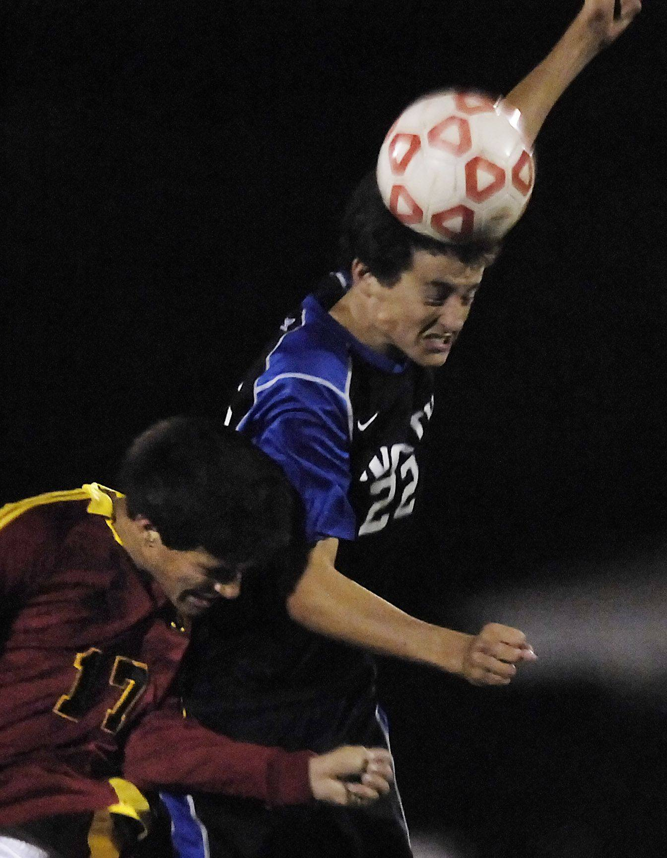 St. Charles North's Jared Casey heads the ball against Batavia's Nick Barstatis Wednesday.