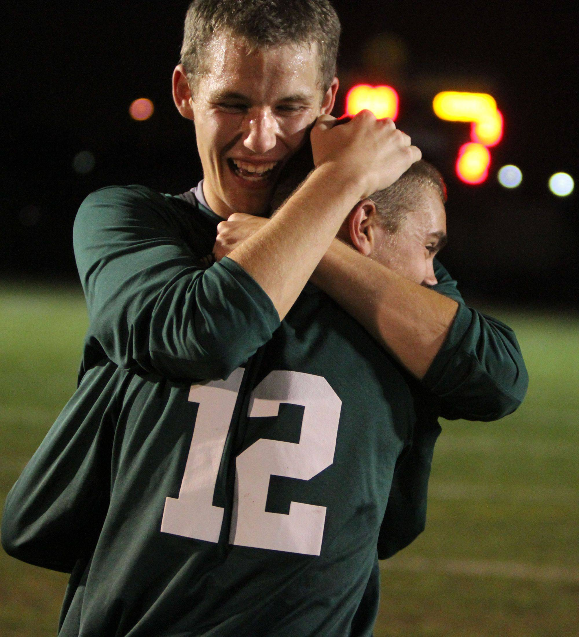 Fremd?s Alex Bochat, right, gets a big hug from teammate Alex Prelipceanu after their team deafeated Elk Grove Thursday.