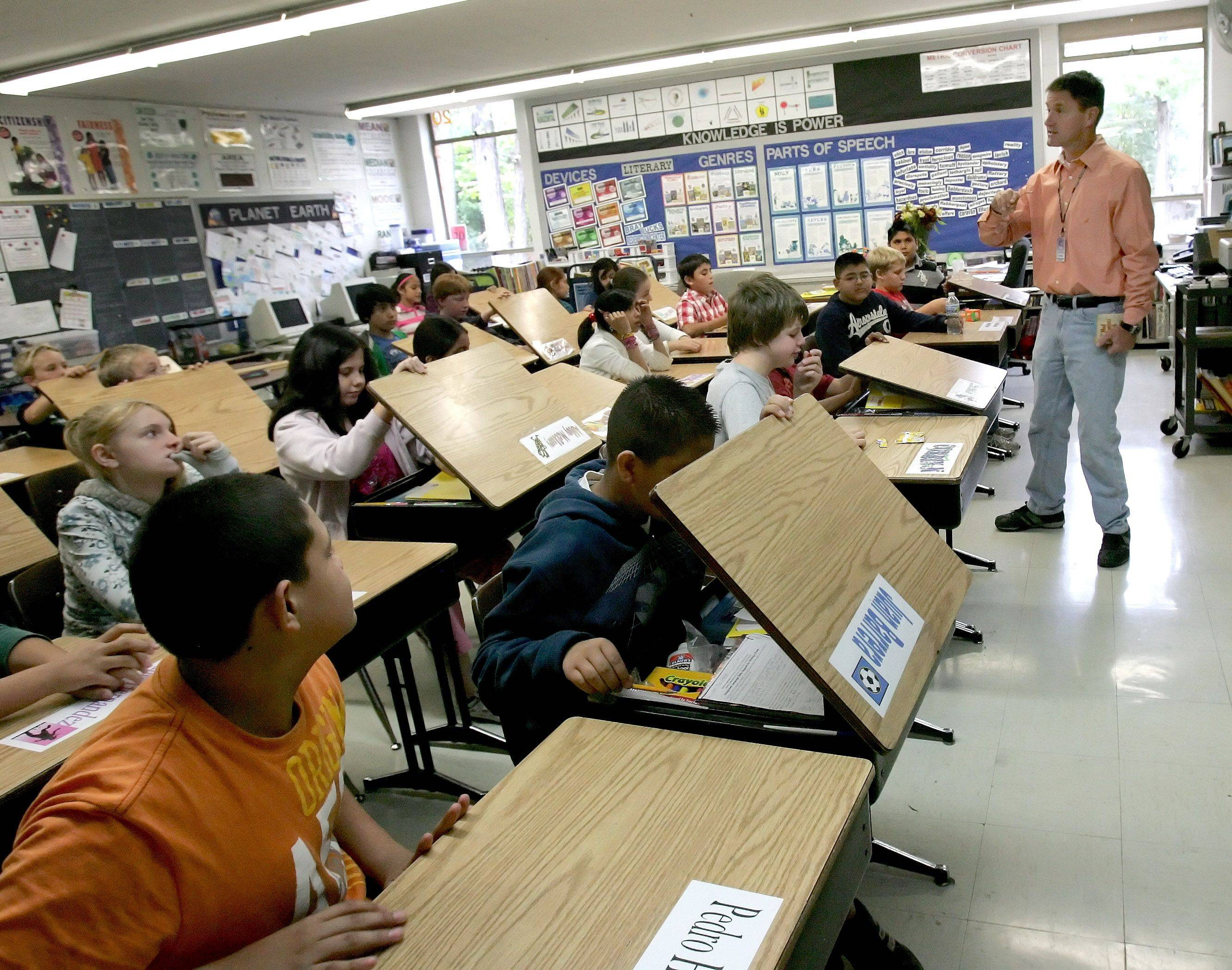 Sixth-grade teacher Steve Brugmann has 28 students in his class at Turner Elementary School in West Chicago.