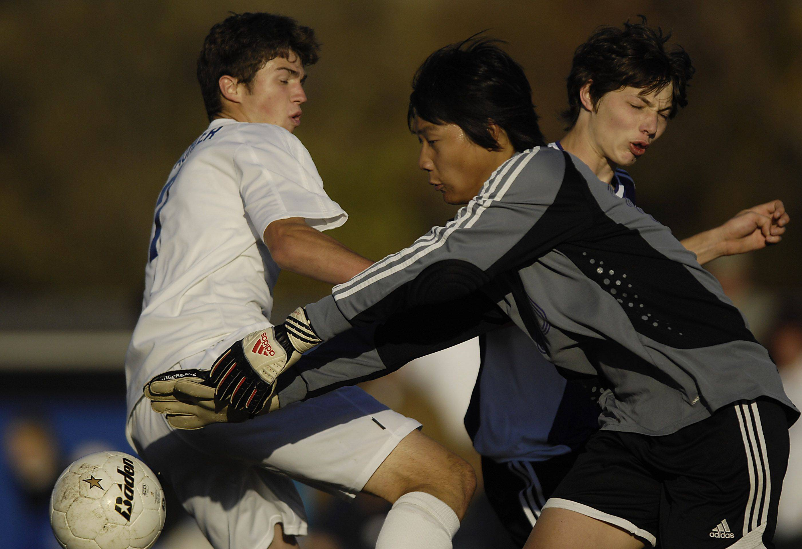 Westminster Christian's Josh Beachler gets to the ball as North Shore Country Day goalkeeper Fred Cheon grabs it and Peter Milling supports his keeper Tuesday in the Class 1A regional championship.