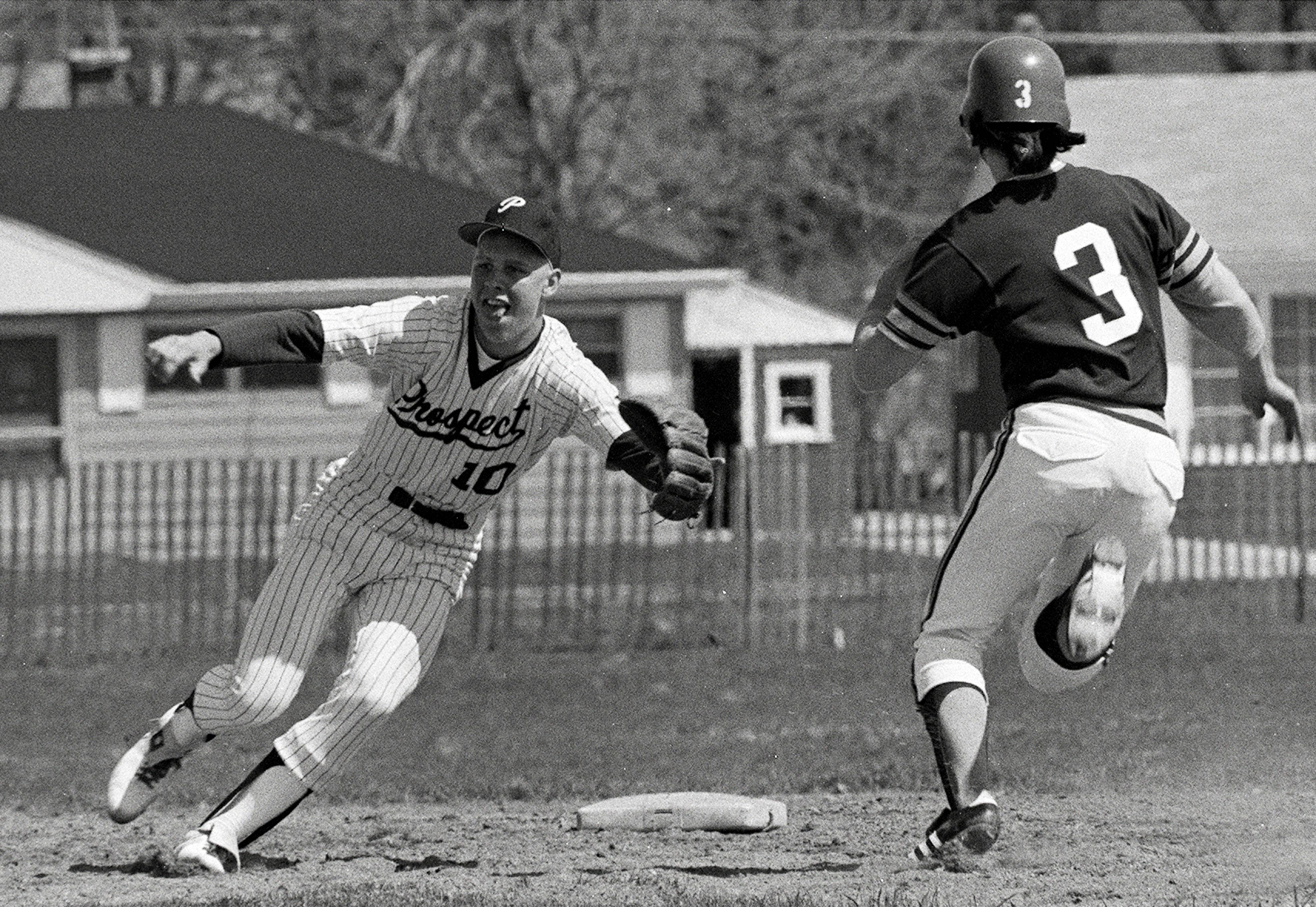 Mike Quade (left) played baseball for Mt. Prospect as shortstop back in 1974.