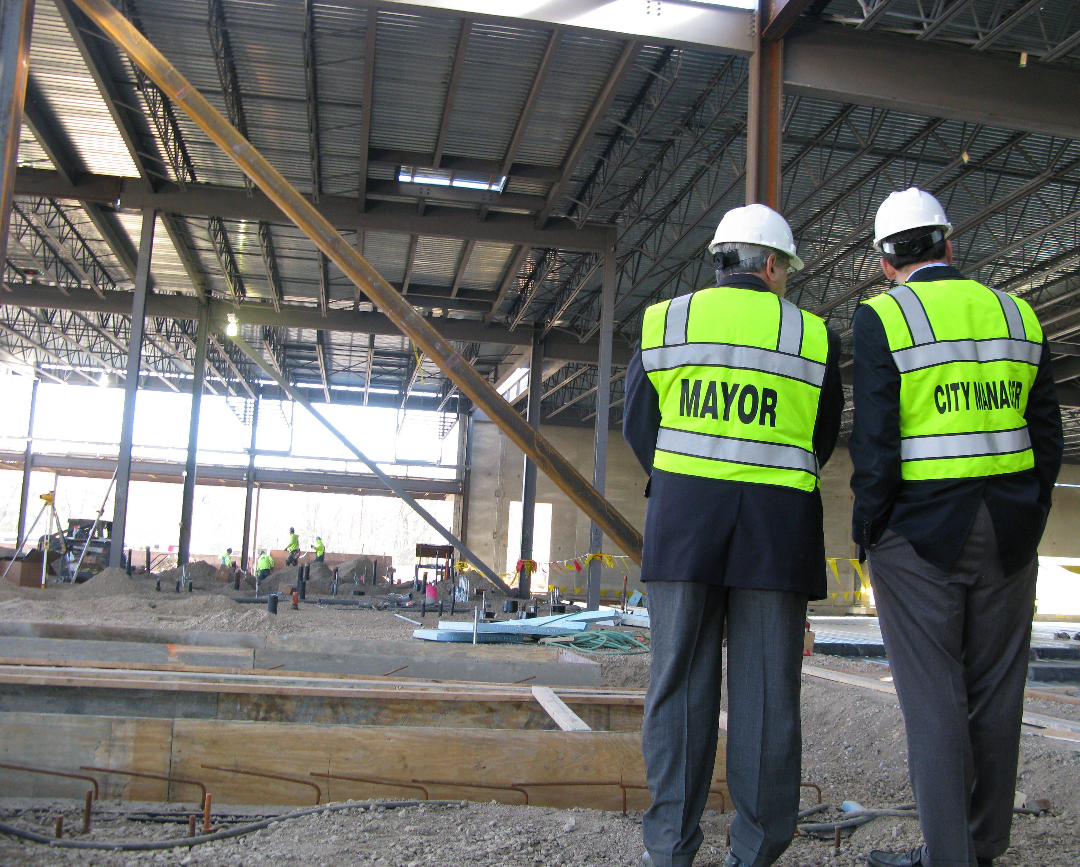 Des Plaines Mayor Marty Moylan, left, and acting City Manager Jason Slowinski survey the casino construction site Thursday.