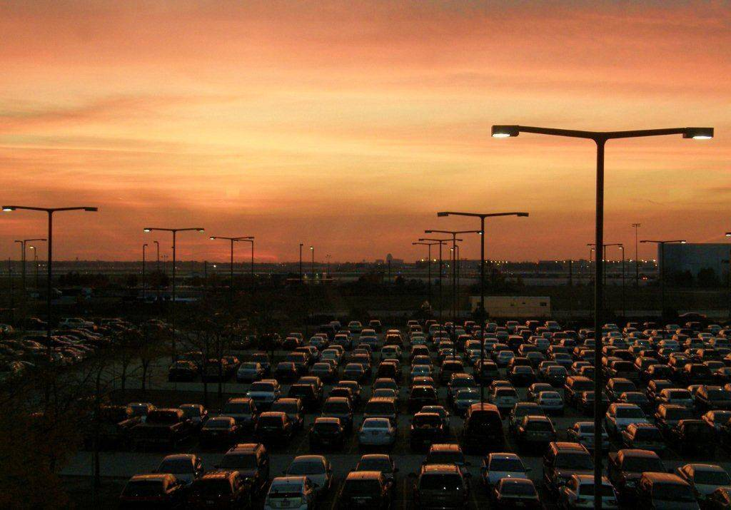 The O'Hare Airport parking lot with a beautiful sunset reflected from the tops of cars.