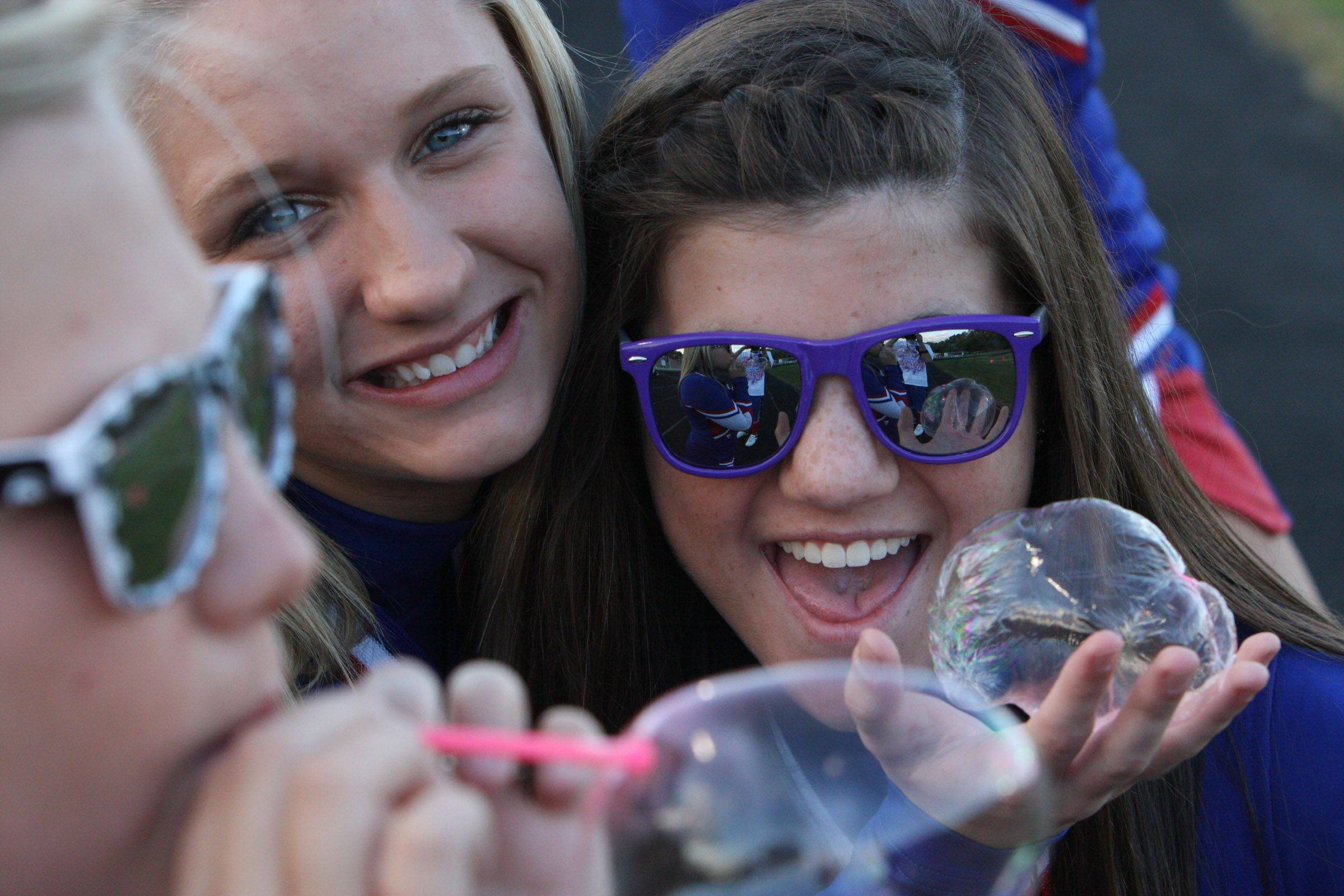 This photo was taken a couple of weeks ago at the Dundee Crown Homecoming game. I was looking to take a photo of my friend blowing bubbles when two other girls wanted to get into the picture.