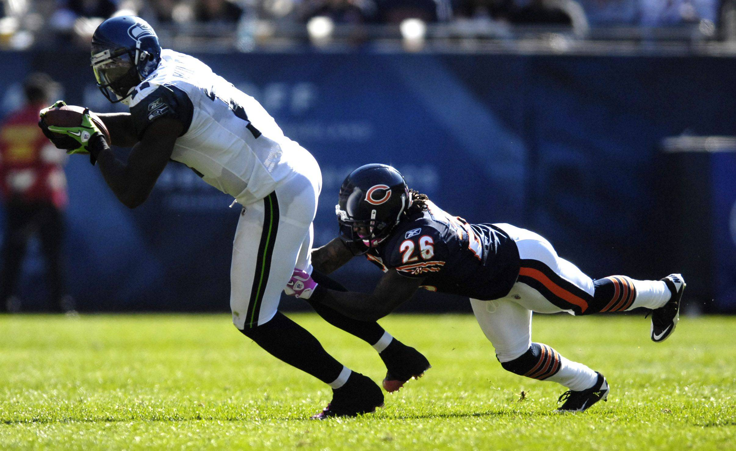 Seattle Seahawks wide receiver Mike Williams is tackled by Chicago Bears cornerback Tim Jennings during Sunday's game at Soldier Field in Chicago.