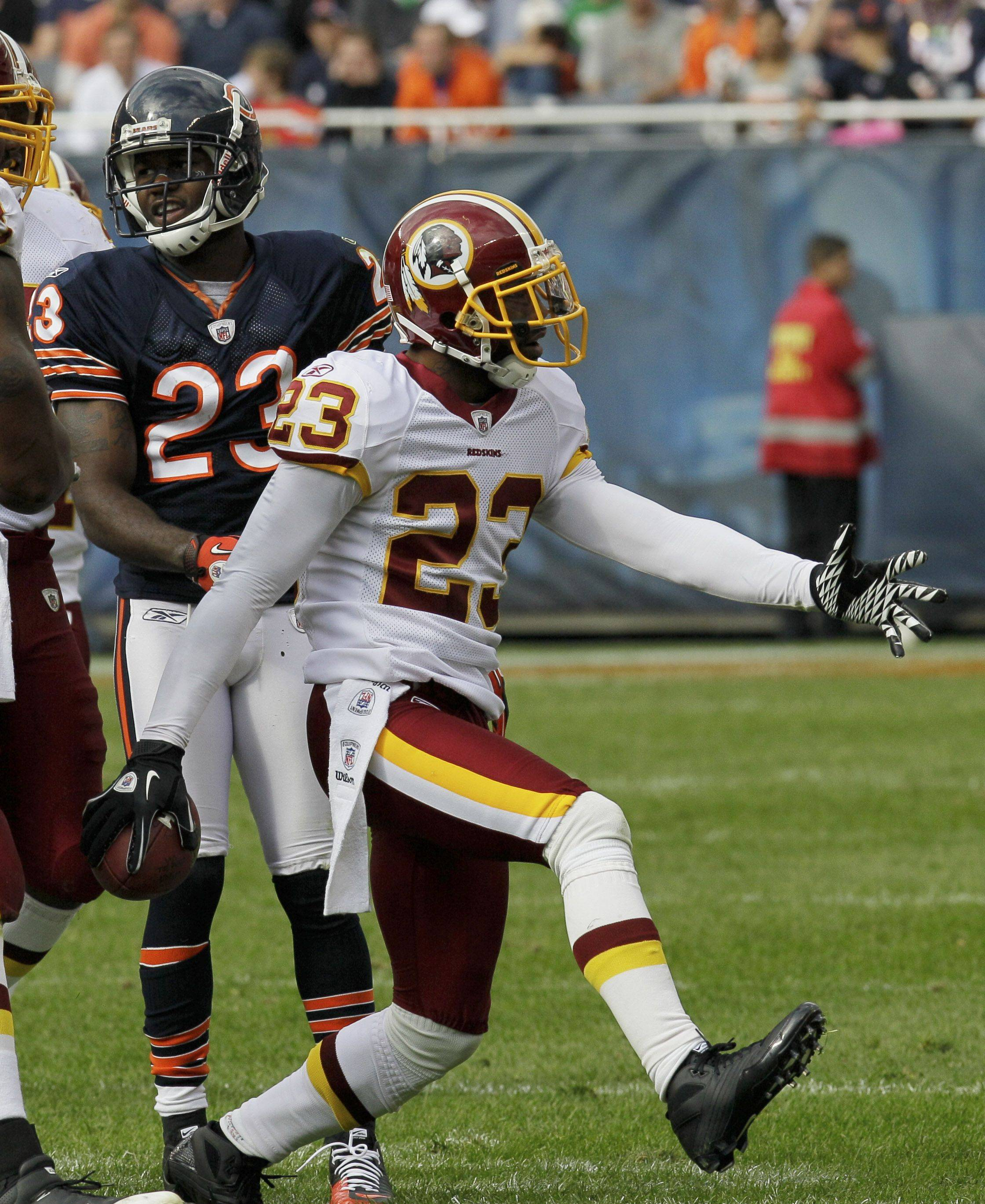 Washington Redskins cornerback DeAngelo Hall celebrates after intercepting a Chicago Bears pass in the second half. Looking on is Bears wide receiver Devin Hester.