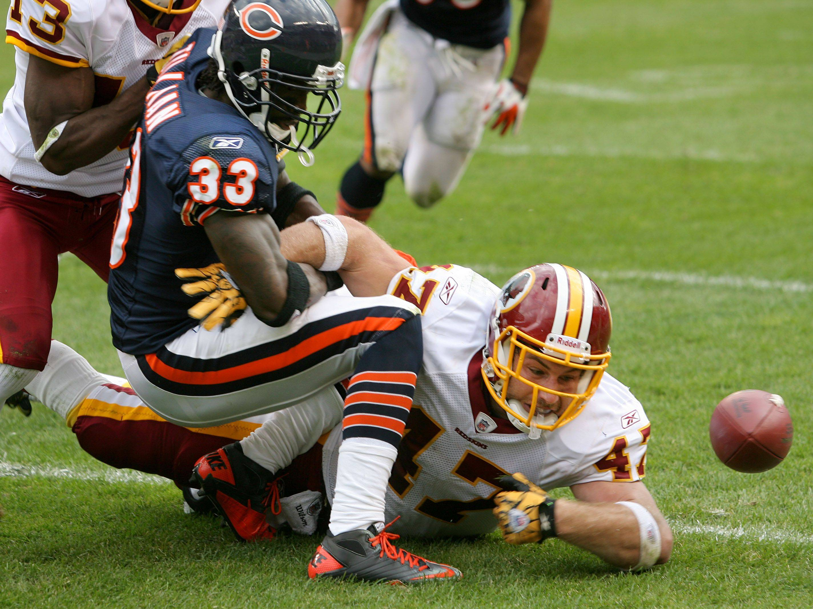 Washington Redskins tight end Chris Cooley tries to bat a fumble out of bounds after Chicago Bears cornerback Charles Tillman forced a fumble during the Bears' 14-17 loss to the Redskins.