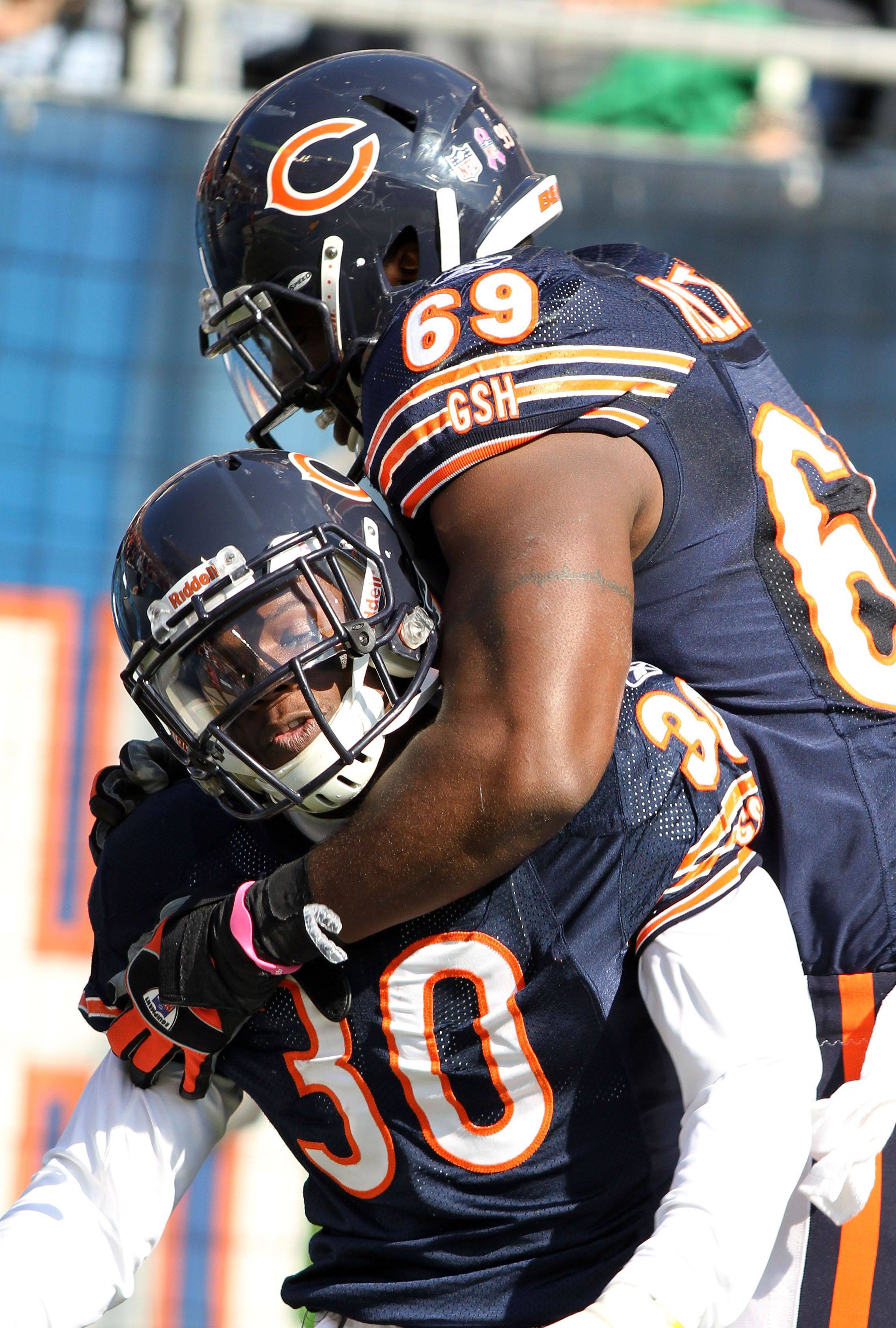 Chicago Bears cornerback D.J. Moore and Chicago Bears defensive end Henry Melton celebrate after Moore's interception for touchdown during the Bears' 14-17 loss to the Redskins.