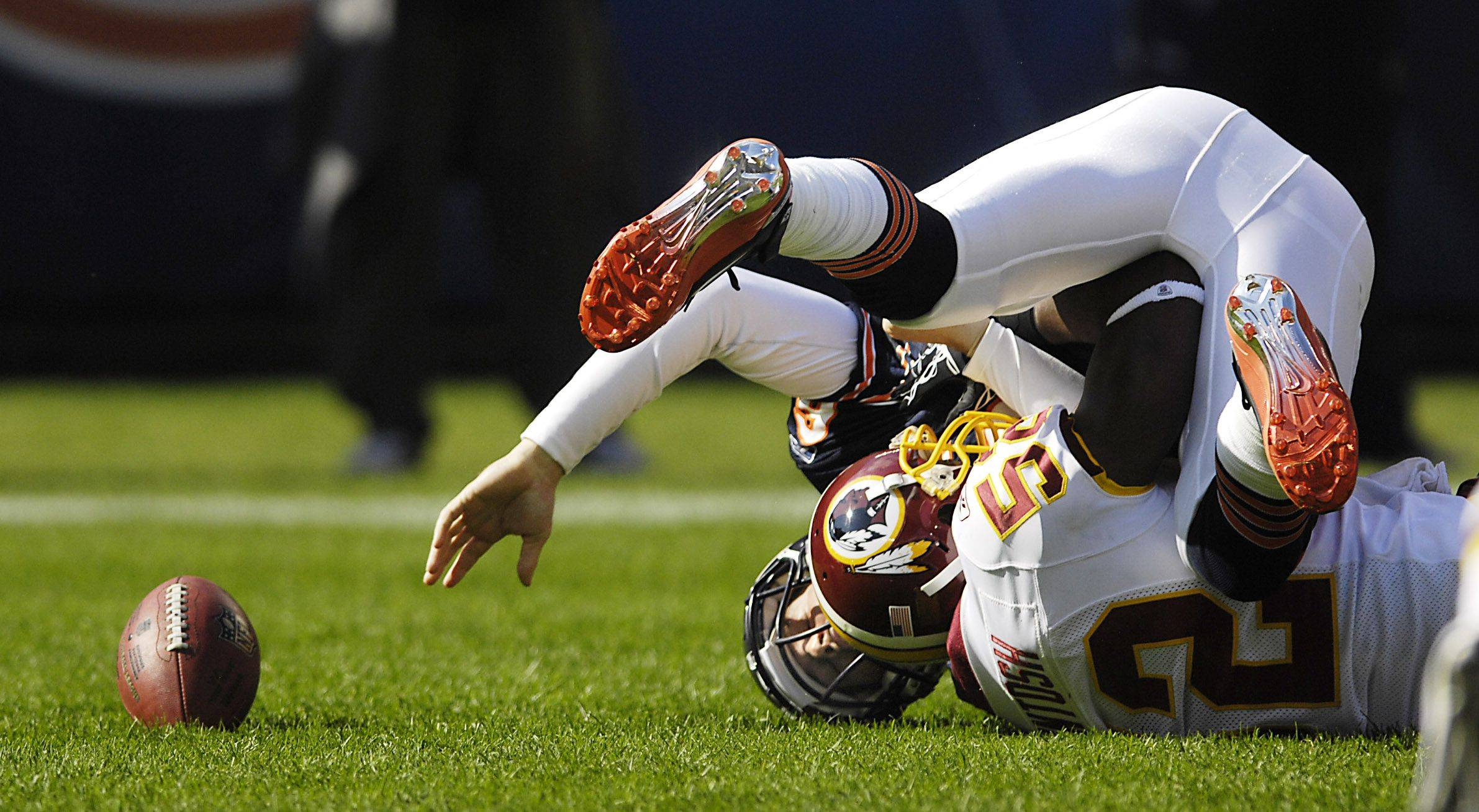 Chicago Bears quarterback Jay Cutler loses the ball as he is sacked by Washington Redskins linebacker Rocky McIntosh. He was ruled down with no fumble.