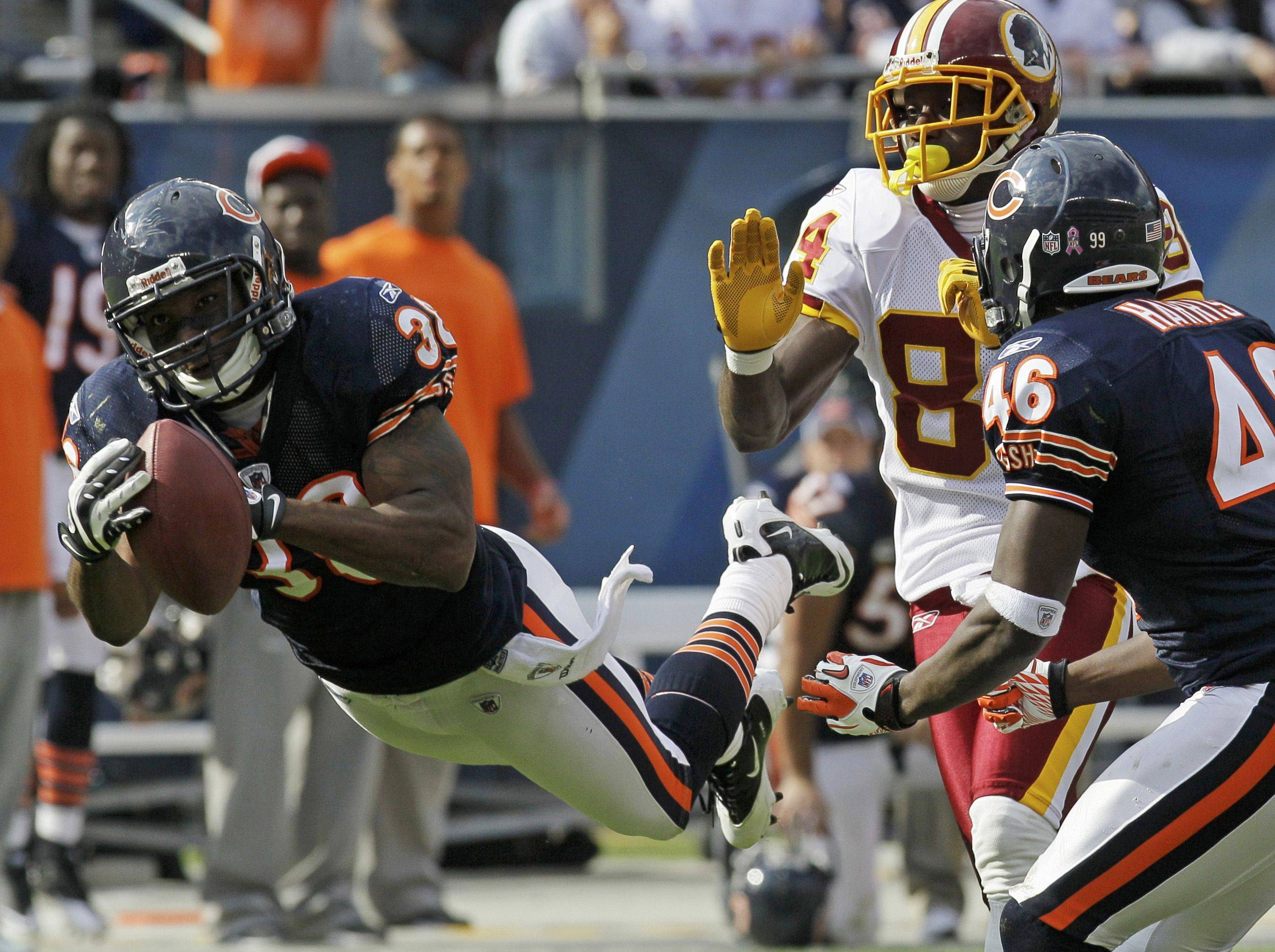 Chicago Bears safety Danieal Manning, left, intercepts a pass intended for Washington Redskins wide receiver Joey Galloway in the second half. Watching the play is Bears safety Chris Harris.