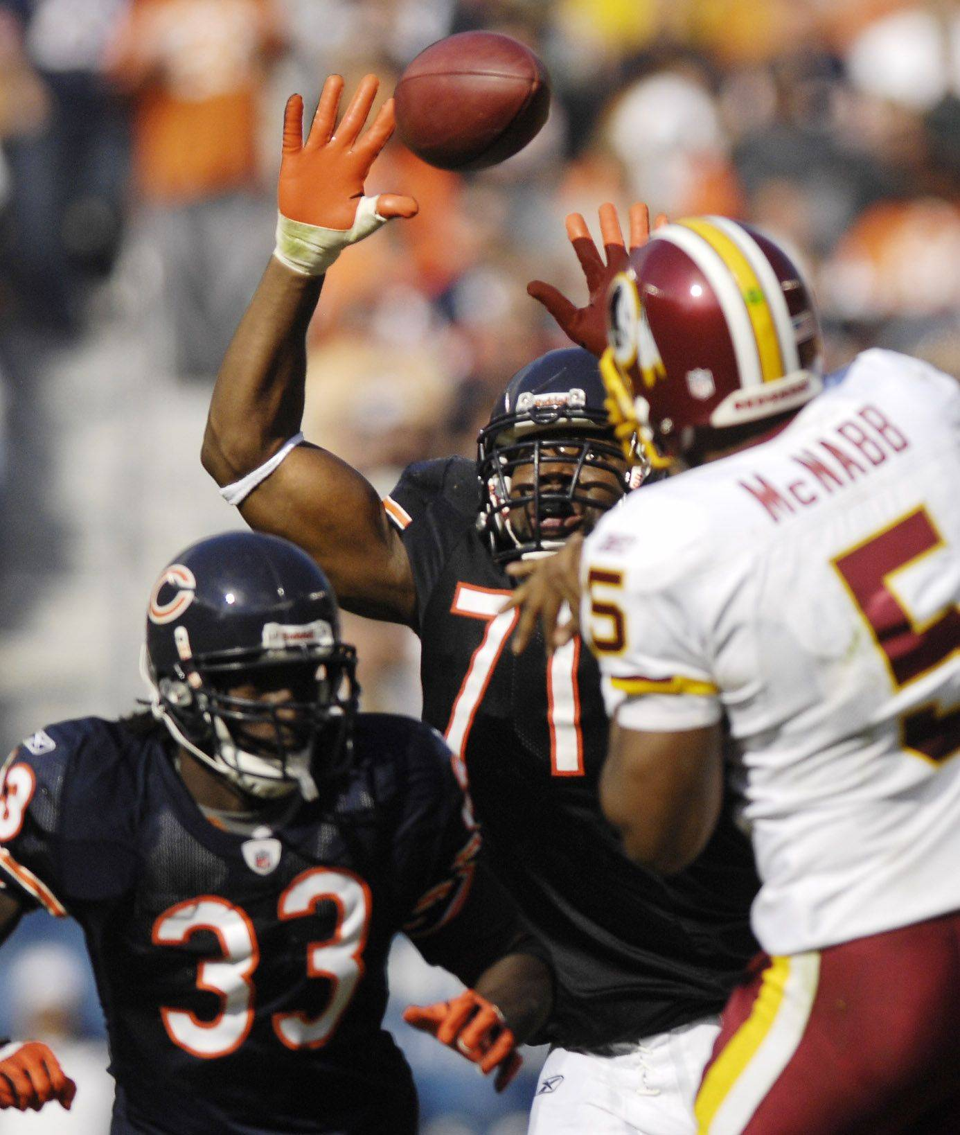 Chicago Bears defensive tackle Israel Idonije bats a Washington Redskins quarterback Donovan McNabb pass.