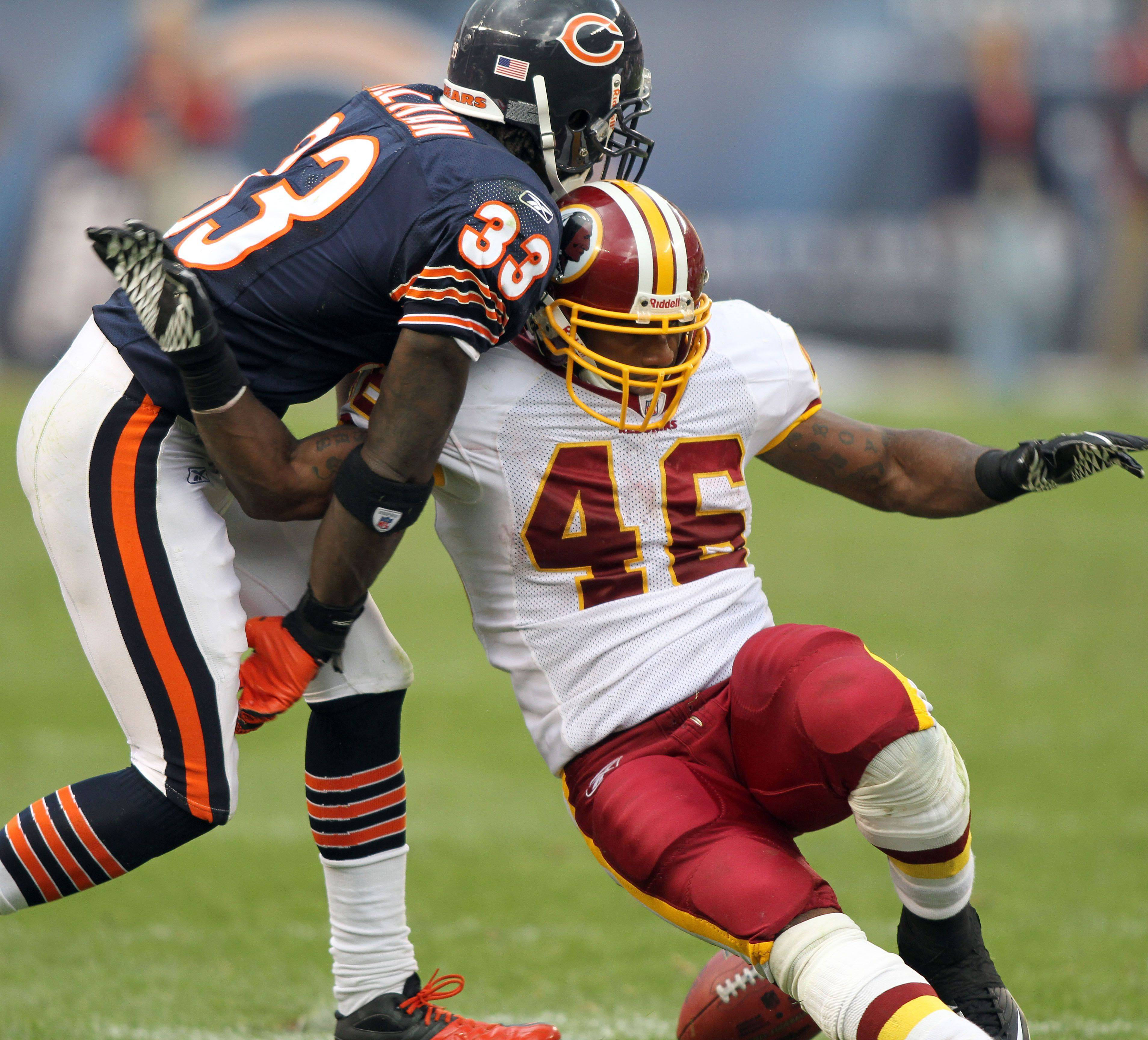 Chicago Bears cornerback Charles Tillman strips the ball from Washington Redskins running back Ryan Torain during the Bears' 14-17 loss to the Redskins.
