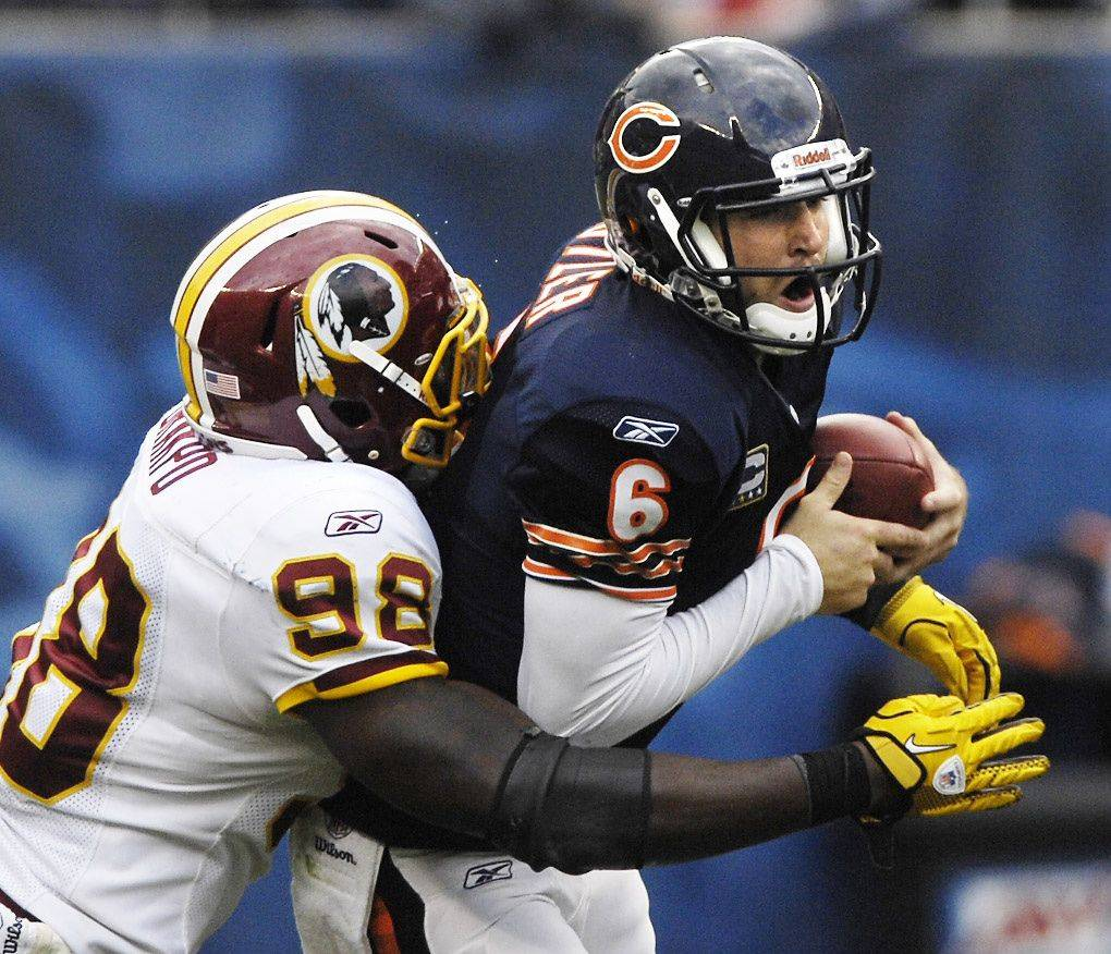 Chicago Bears quarterback Jay Cutler is sacked by Washington Redskins linebacker Brian Orakpo.