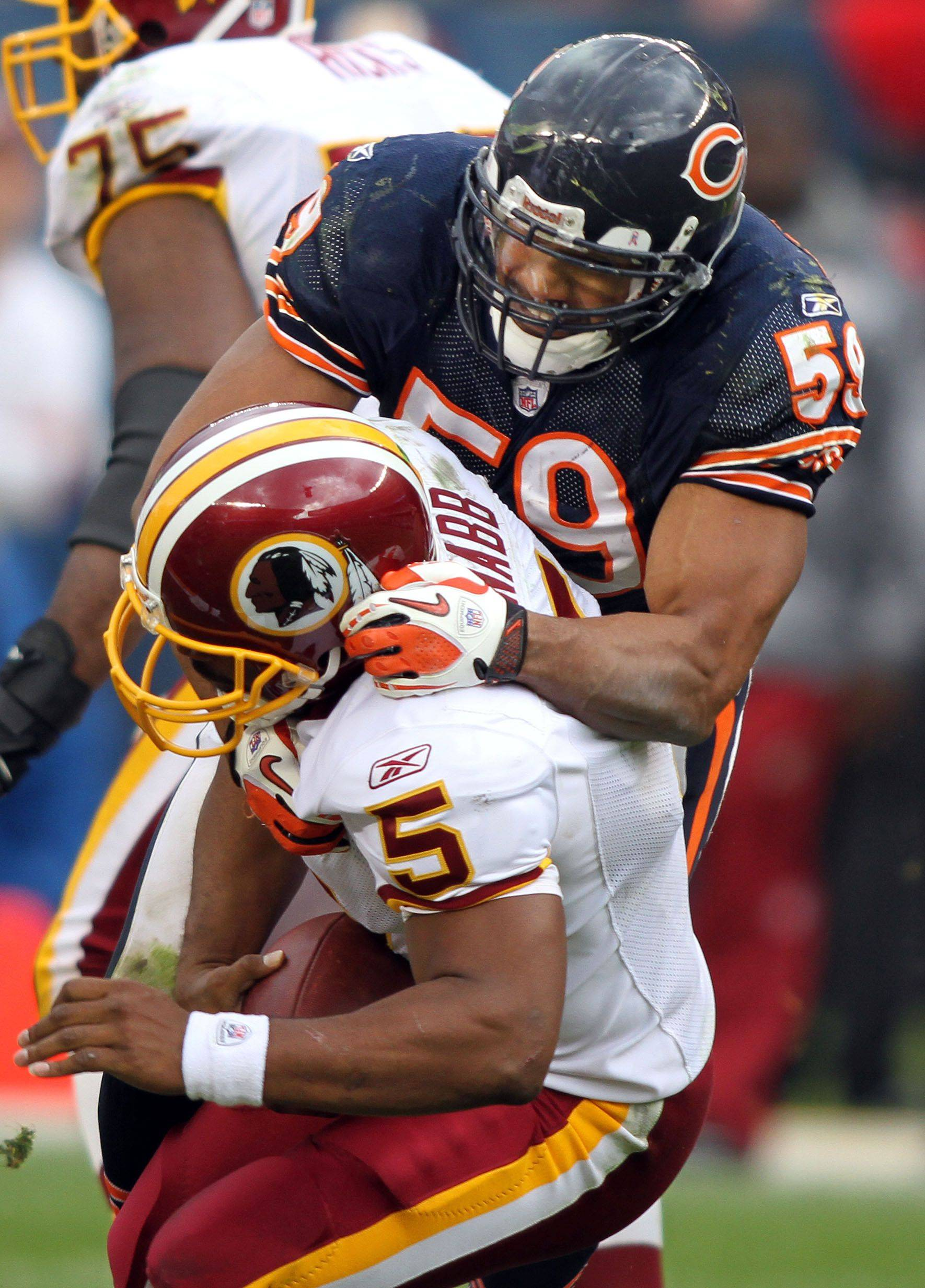 Chicago Bears linebacker Pisa Tinoisamoa sacks Washington Redskins quarterback Donovan McNabb during the Bears' 14-17 loss to the Redskins.