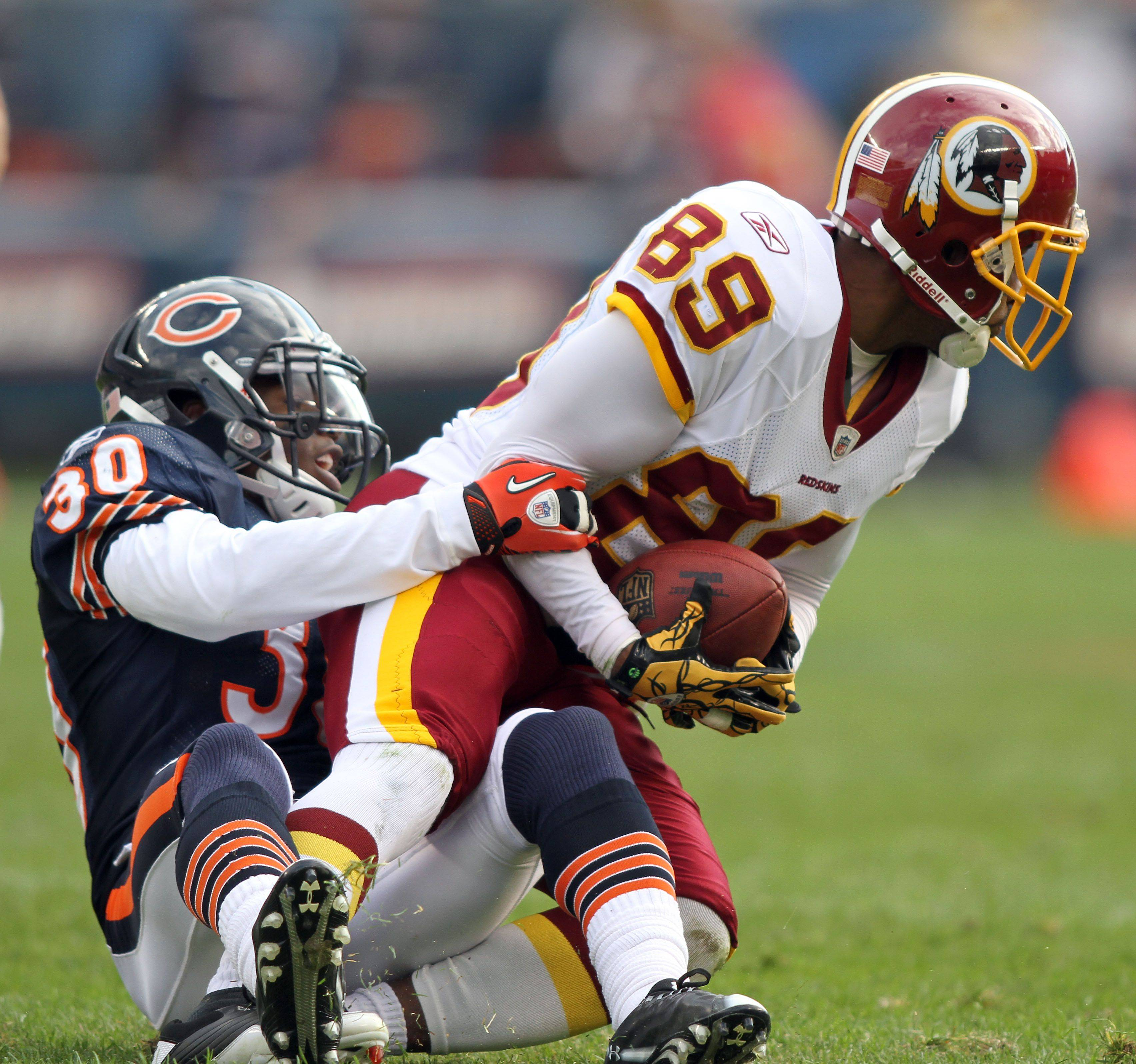 Chicago Bears cornerback D.J. Moore tackles Washington Redskins wide receiver Santana Moss during the Bears' 14-17 loss to the Redskins.