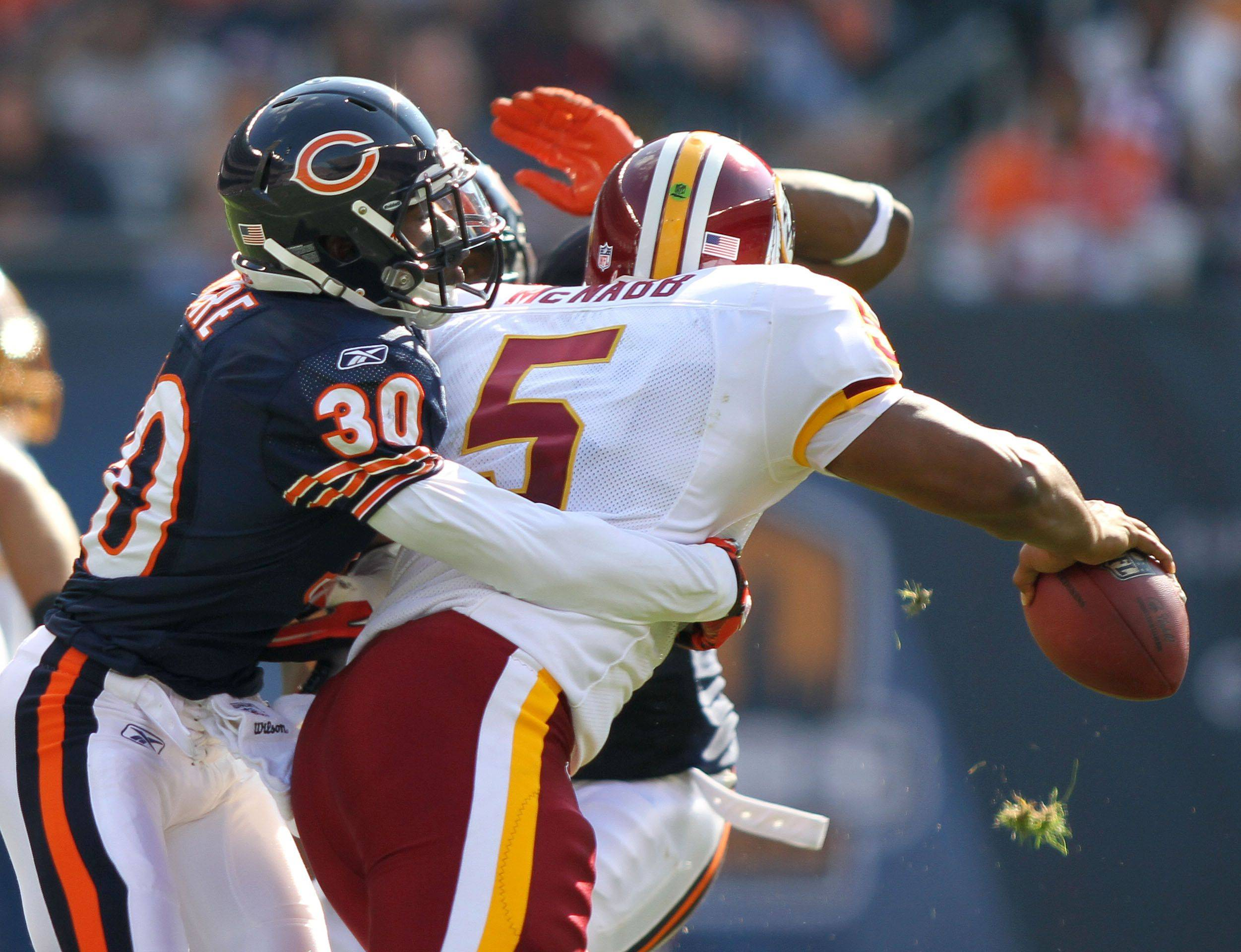 Chicago Bears cornerback D.J. Moore sacks Washington Redskins quarterback Donovan McNabb during the Bears' 14-17 loss to the Redskins.
