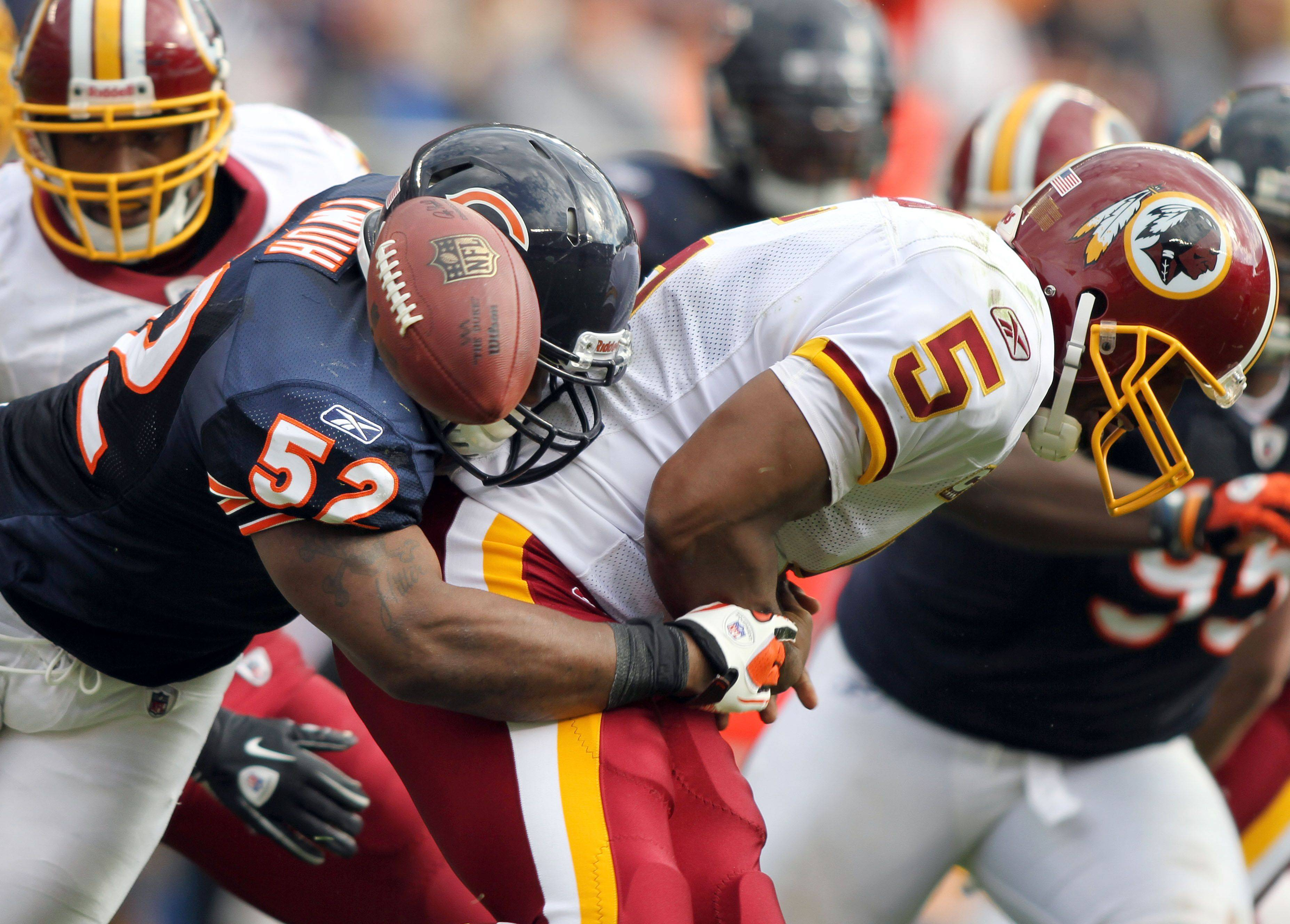 Chicago Bears linebacker Brian Iwuh sacks Washington Redskins quarterback Donovan McNabb during the Bears' 14-17 loss to the Redskins.