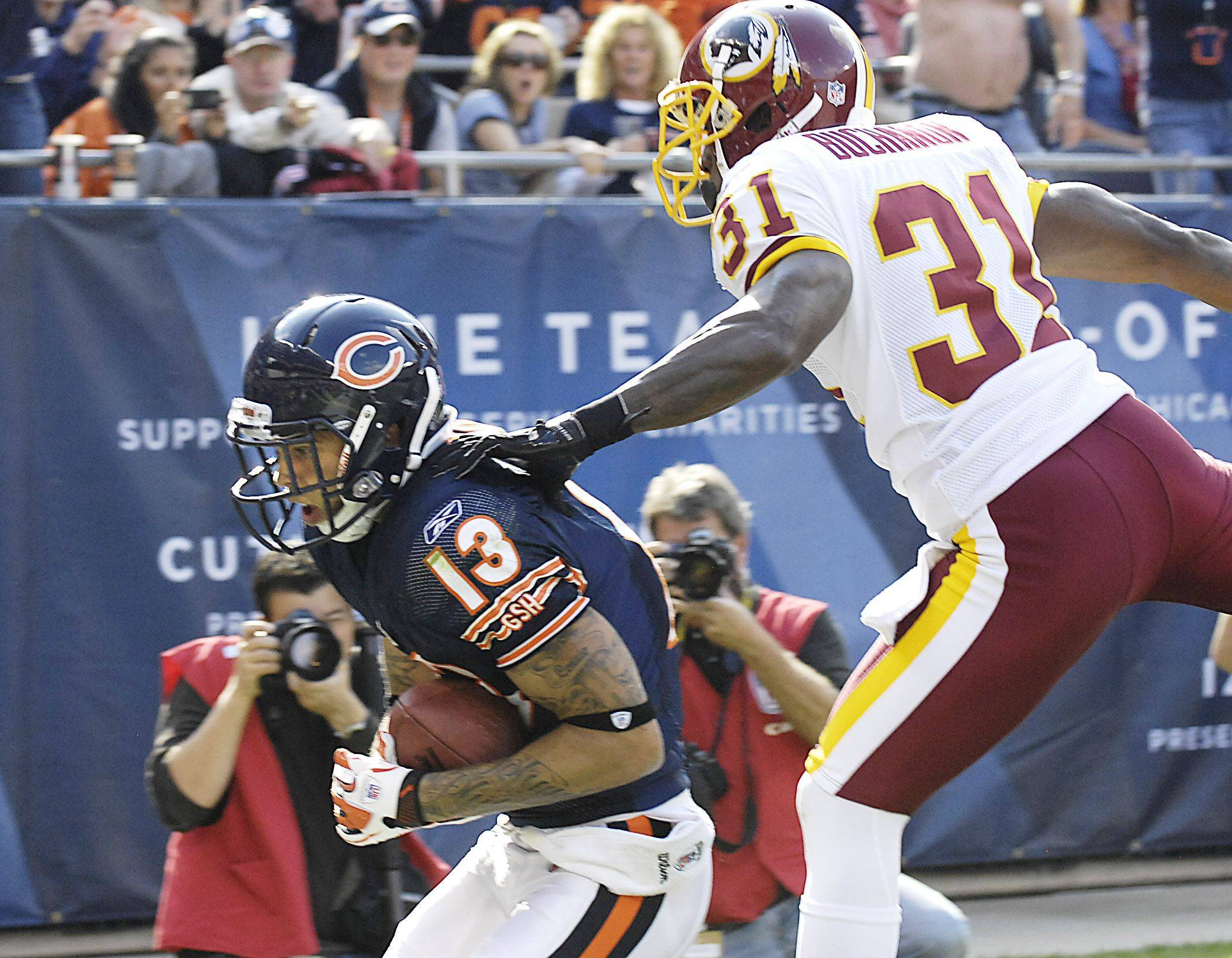 Chicago Bears wide receiver Johnny Knox catches a touchdown pass from Jay Cutler as Washington Redskins cornerback Phillip Buchanon defends.