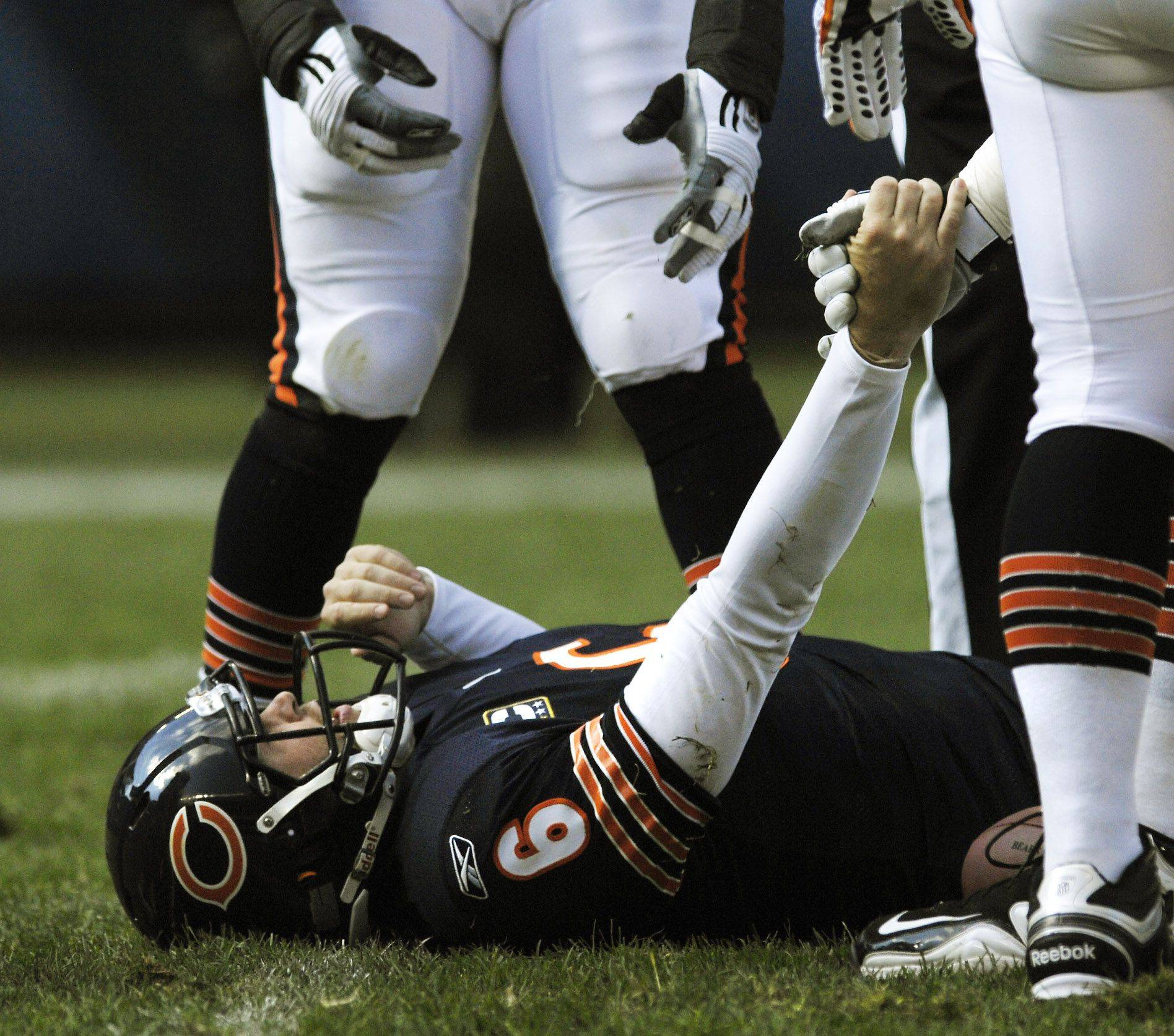 Chicago Bears quarterback Jay Cutler is helped up after a sack in the first half against the Washington Redskins.