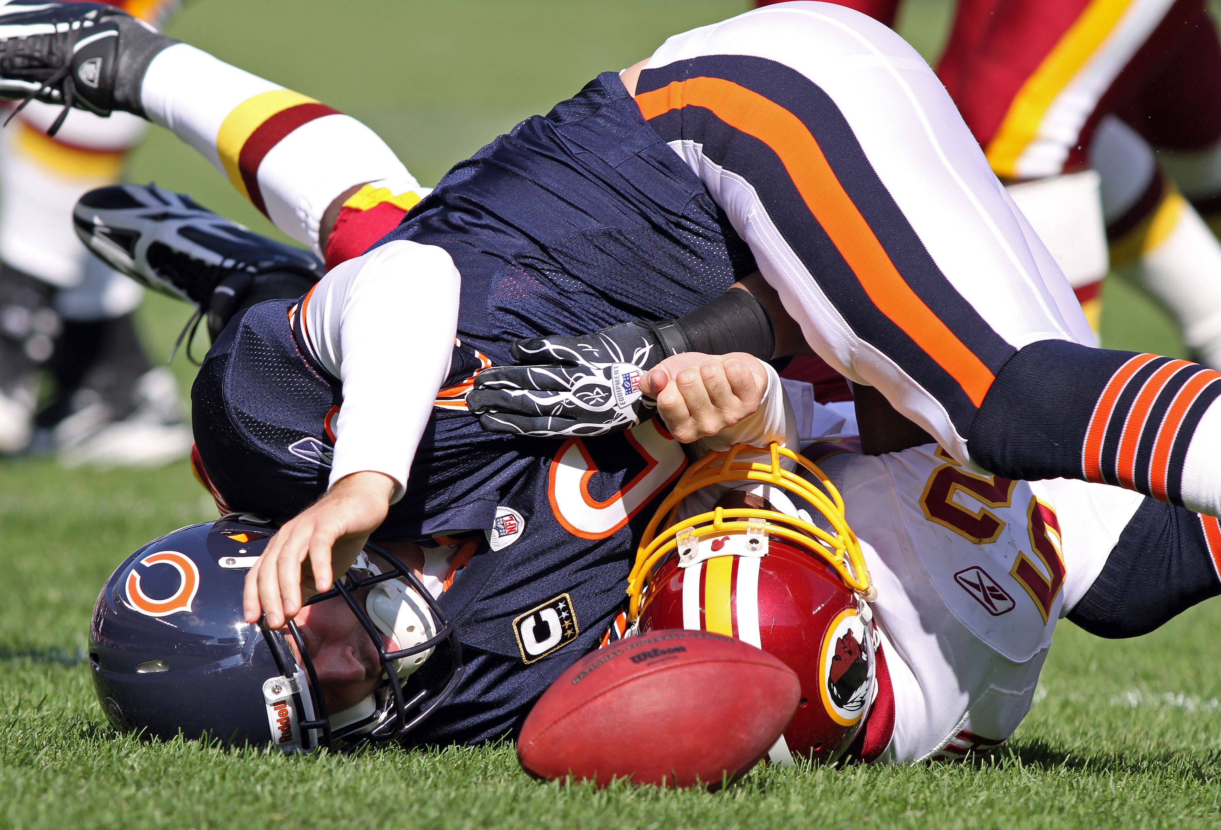 Chicago Bears quarterback Jay Cutler is sacked by Washington Redskins linebacker Rocky McIntosh during the Bears' 14-17 loss to the Redskins.