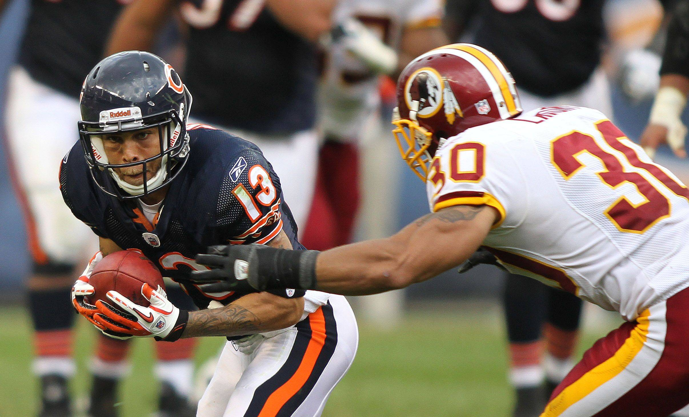 Chicago Bears wide receiver Johnny Knox runs after a catch with Washington Redskins safety LaRon Landry defending during the Bears' 14-17 loss to the Redskins.