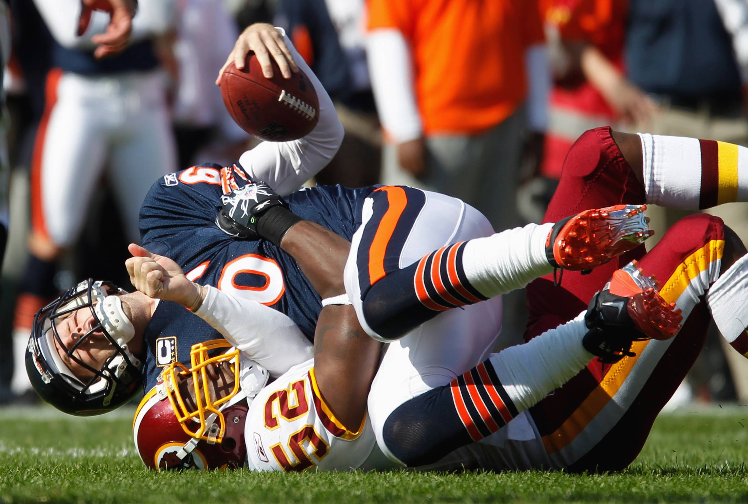 Bears quarterback Jay Cutler is sacked by Washington Redskins linebacker Rocky McIntosh.