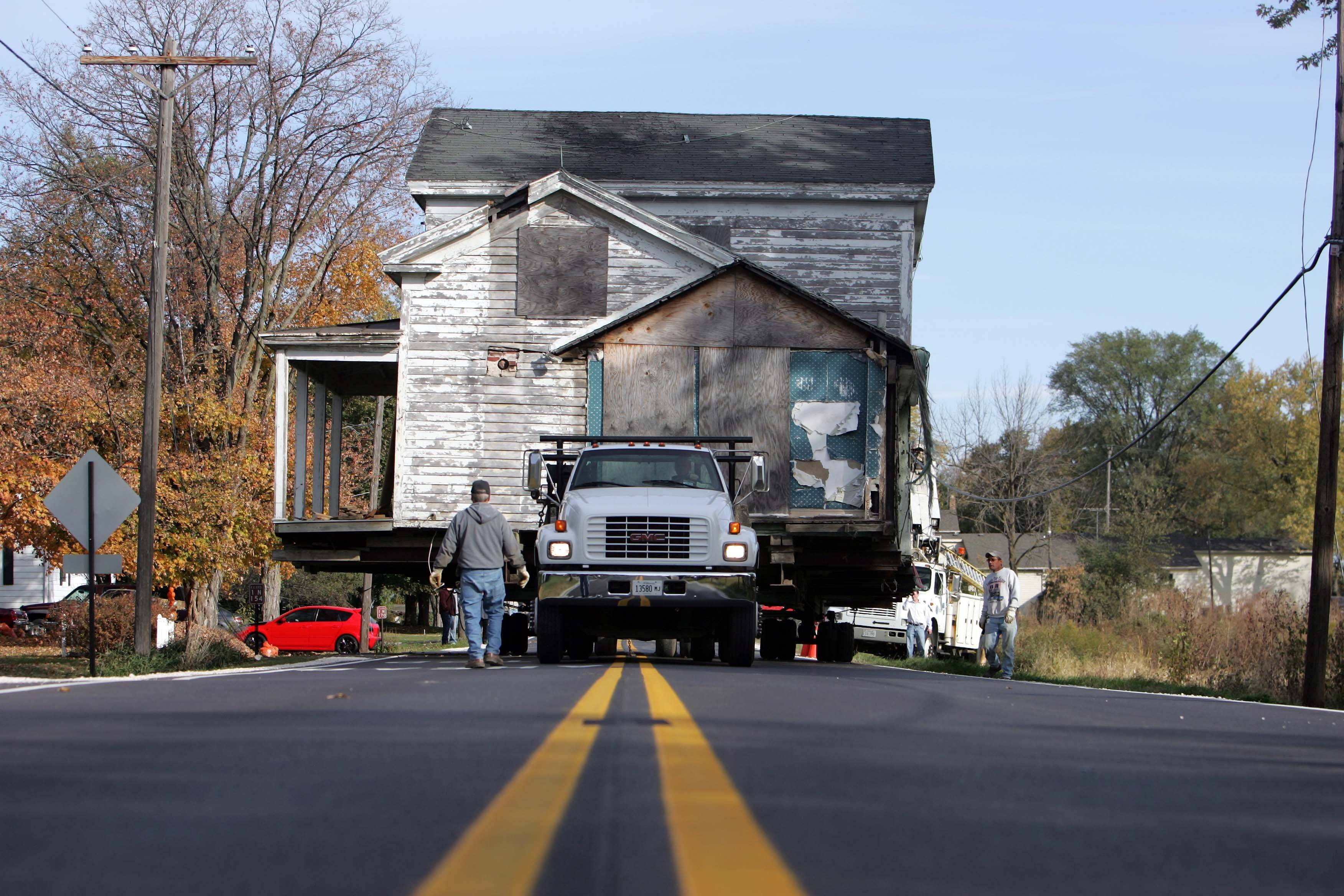 "For the second time in a little more than two and a half years, the more than 30-ton home has moved to a new location. Originally close to the new train station in La Fox the home was moved to lot on La Fox Road. Dan Larsen, who bought the house for a dollar is planning on turning it into a guest house behind his La Fox home. ""I'd rather see it in my yard than see it out there"" said Larsen who hopes to have the exterior finished by winter. The 1849 home is believed to be the oldest frame structure in Kane County."
