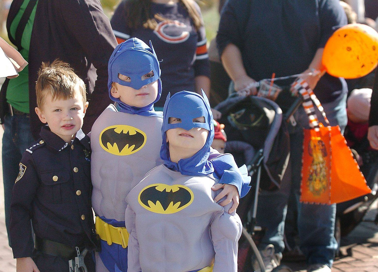 Evan Fahey, left, and bat brothers Nathaniel and Carter Cremascoli wait in the candy line at Mount Prospect's sixth-annual Fall Festival.