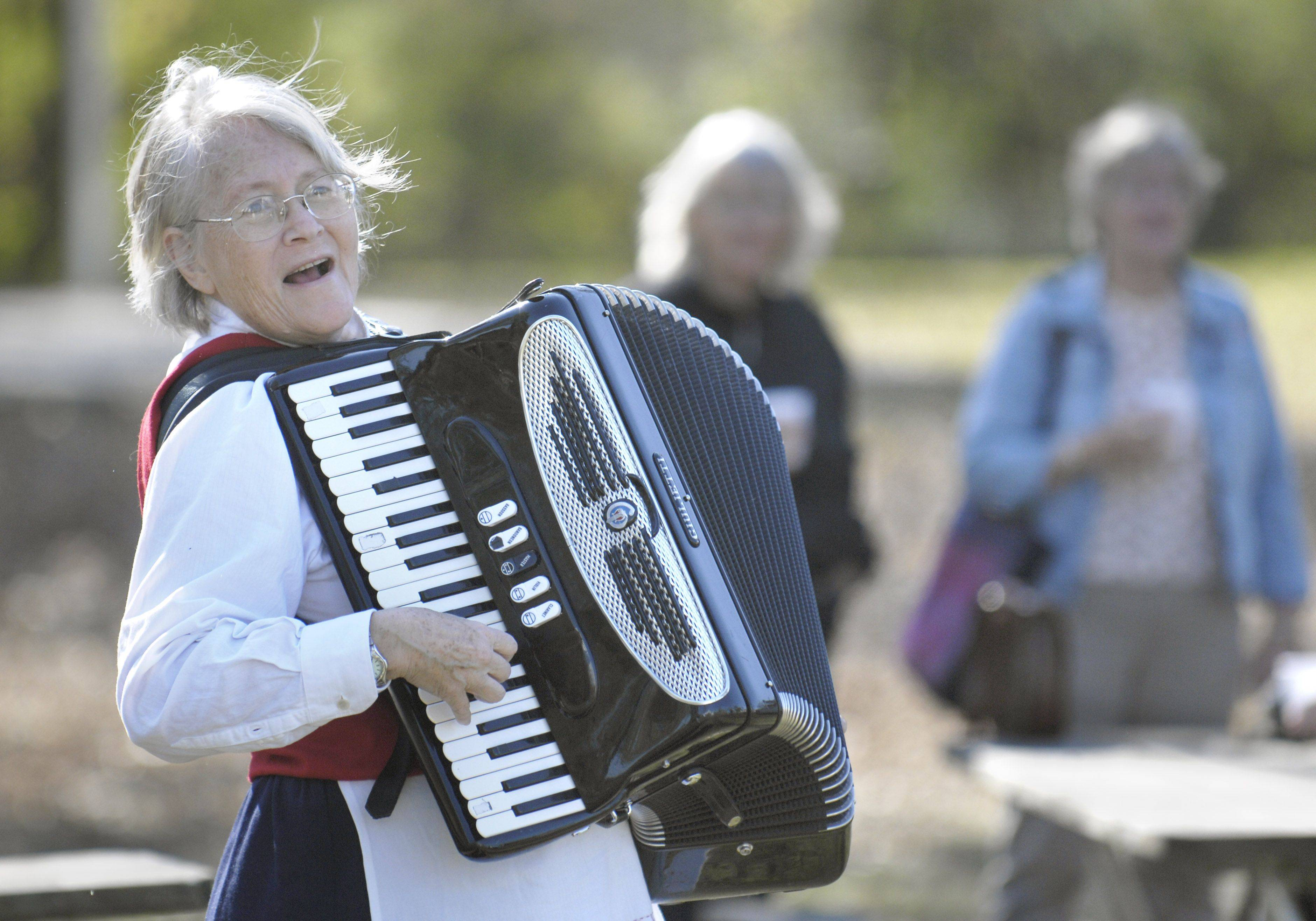 Pat Spaeth of Round Lake entertains guests as they arrive to the 10th-annual Fish Boil & Harvest Fest at Vasa Park in South Elgin. Spaeth is a professional musician and has been playing the accordion since she was 15.