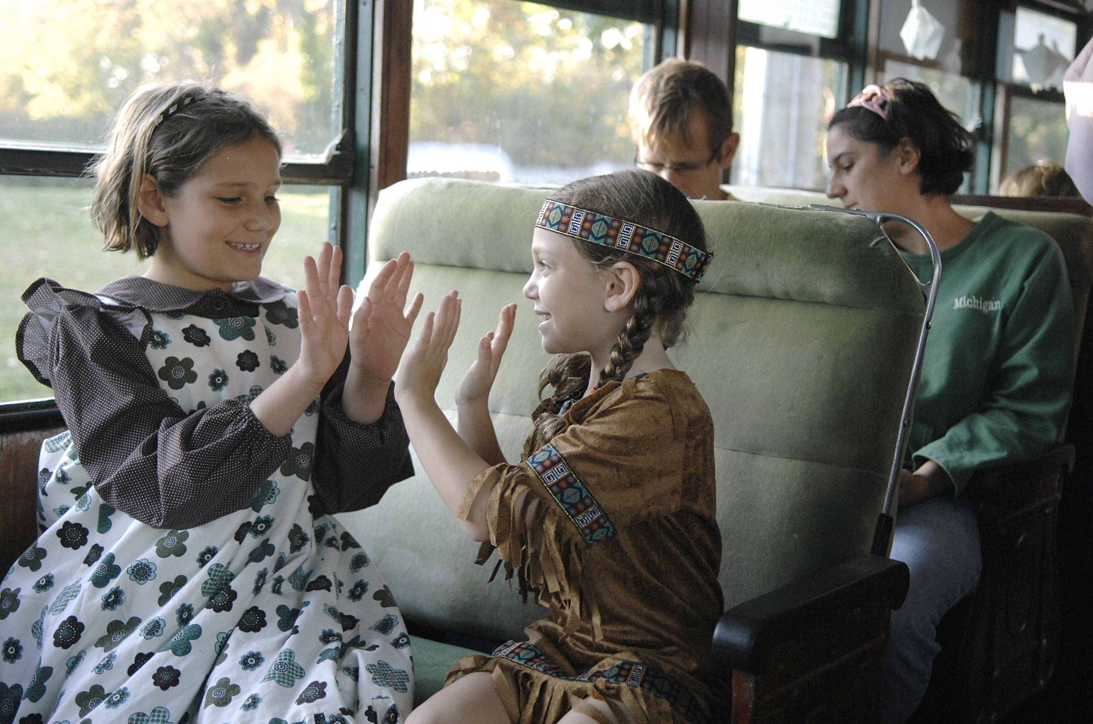 Isabella Rechtin and Ilana Greenstein, both 8 from Winnetka, play a game before the Halloween Hiawatha Ghost Story Train takes off from the Fox River Trolley Museum in South Elgin on Saturday evening, October 16. The train took passengers to the end of the rail line where they were told ghost stories around a campfire.