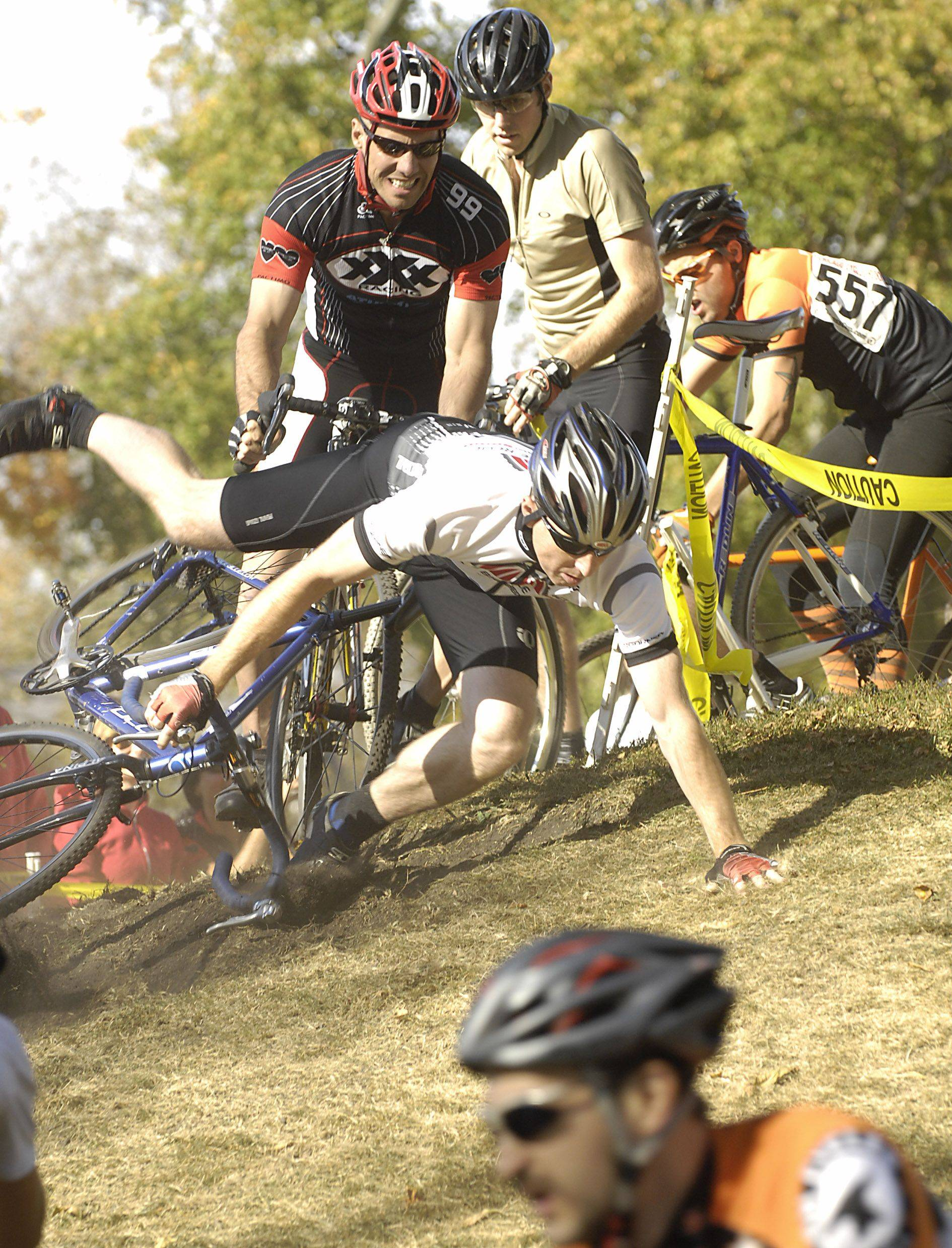Michael Welch of Chicago crashes on Heckle Hill at Sunday's fifth stop of the Chicago Cyclocross at Carpenters Park in Carpentersville.