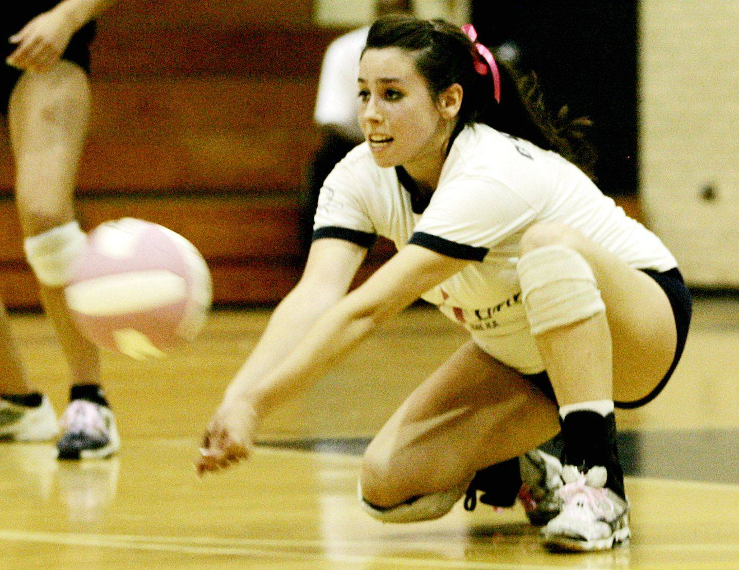 Addison Trail's Katie O'Connor makes a dig against Morton Mustangs during girls volleyball action Monday night.