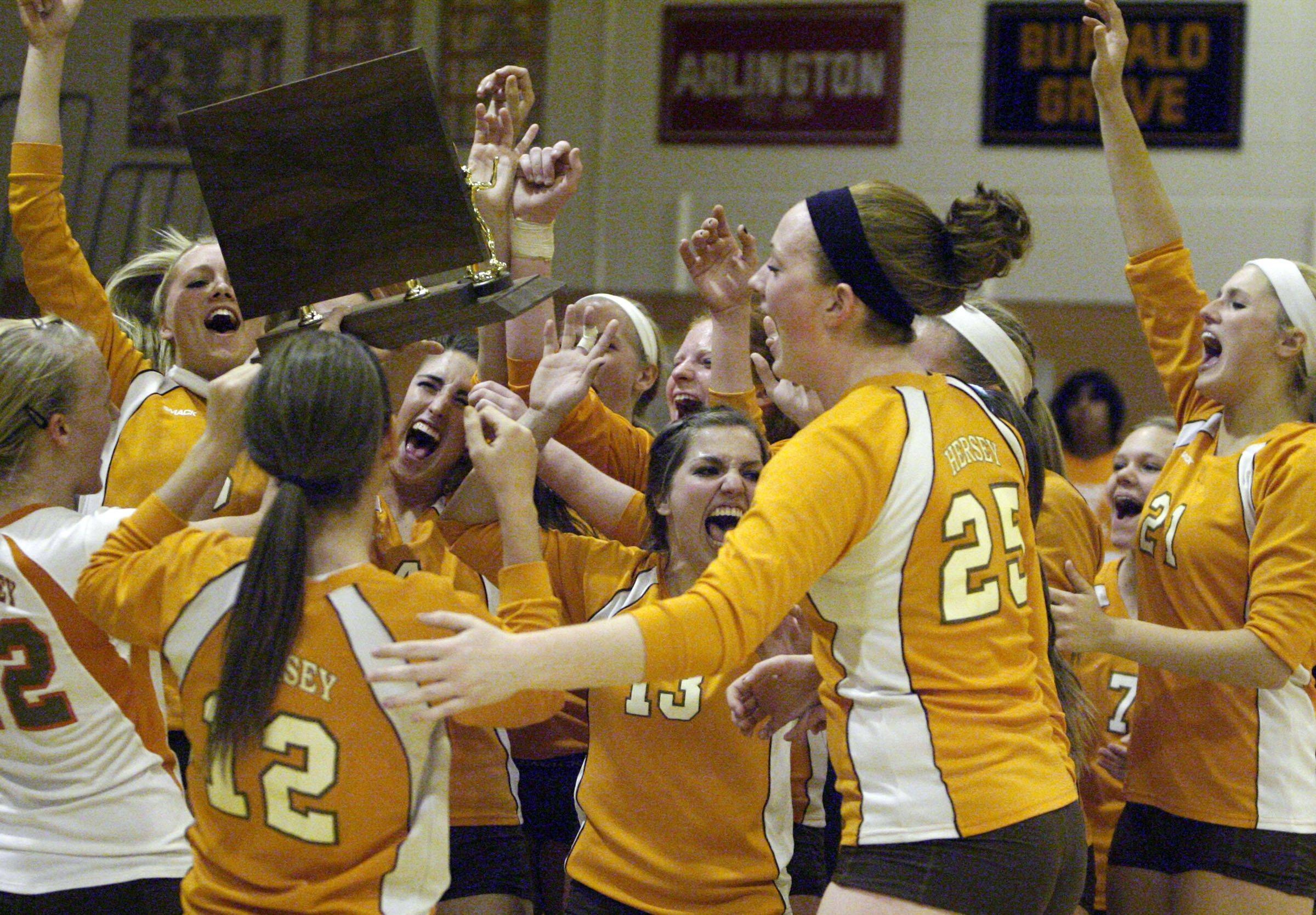 Hersey celebrates their Mid-Suburban League girls volleyball championship Thursday.