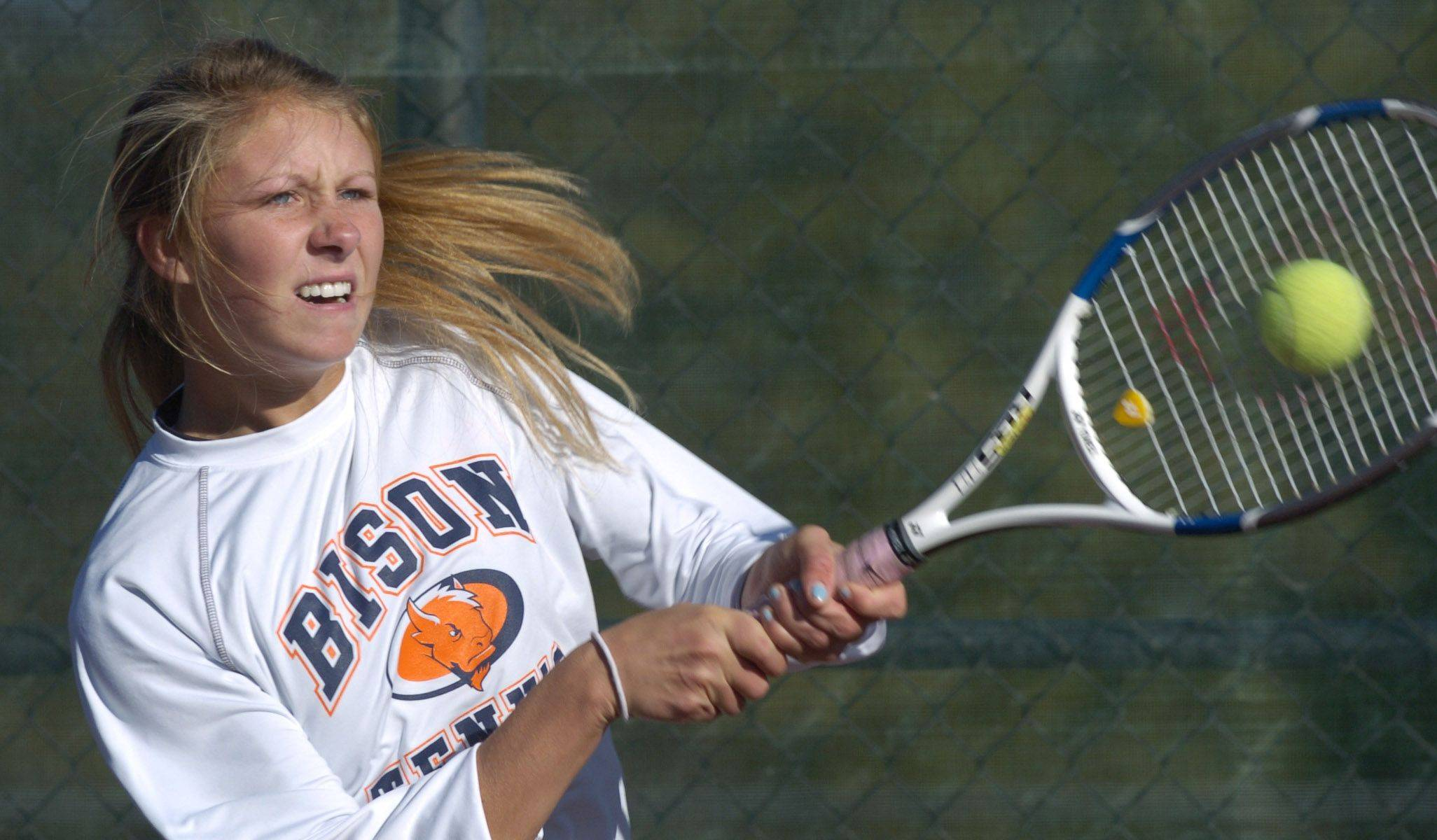 Buffalo Grove's Nell Boyd returns a volley during the state girls tennis tournament at Buffalo Grove High School Thursday.