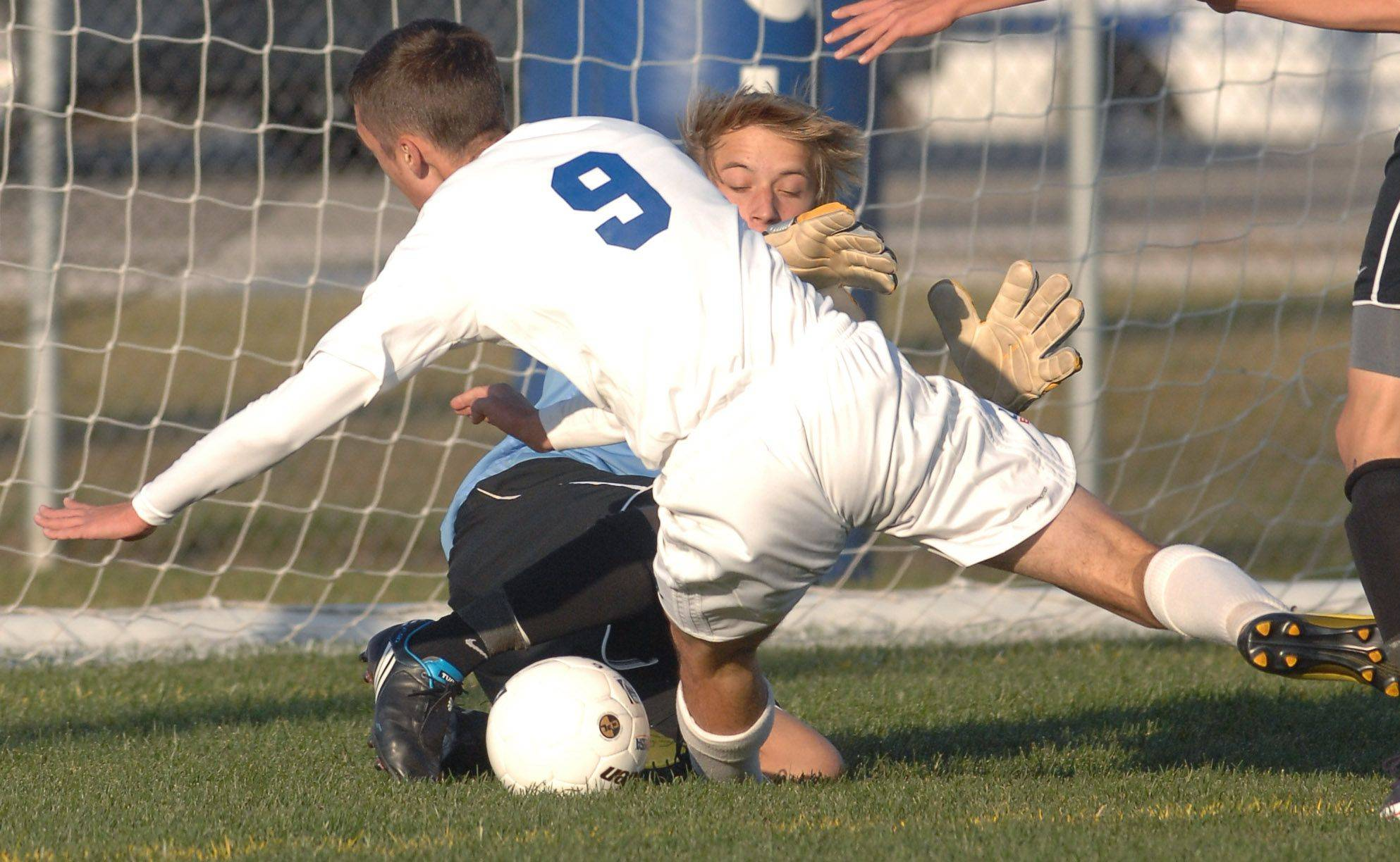 Grayslake North goalkeeper Richard Klarck protects his goal from Lakes' Bojan Zgonjanin, 9, during Tuesday's soccer regional game in Lake Villa.