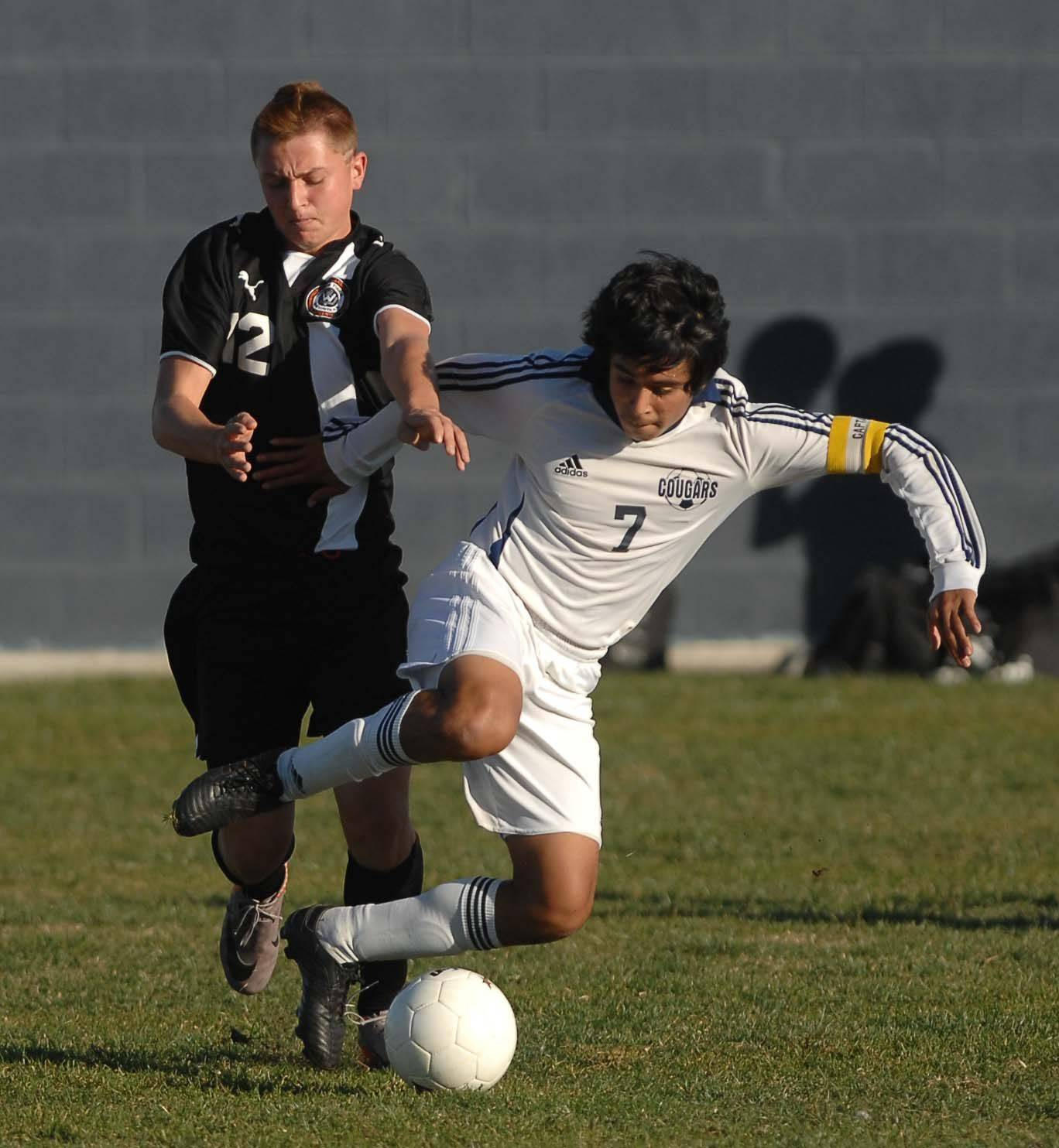 Jarrod Jakubowski,left, of Wheaton Warrenville South and Ivan Valencia of Plainfield South chase down a ball during Wednesday's soccer game at Neuqua Valley High School.