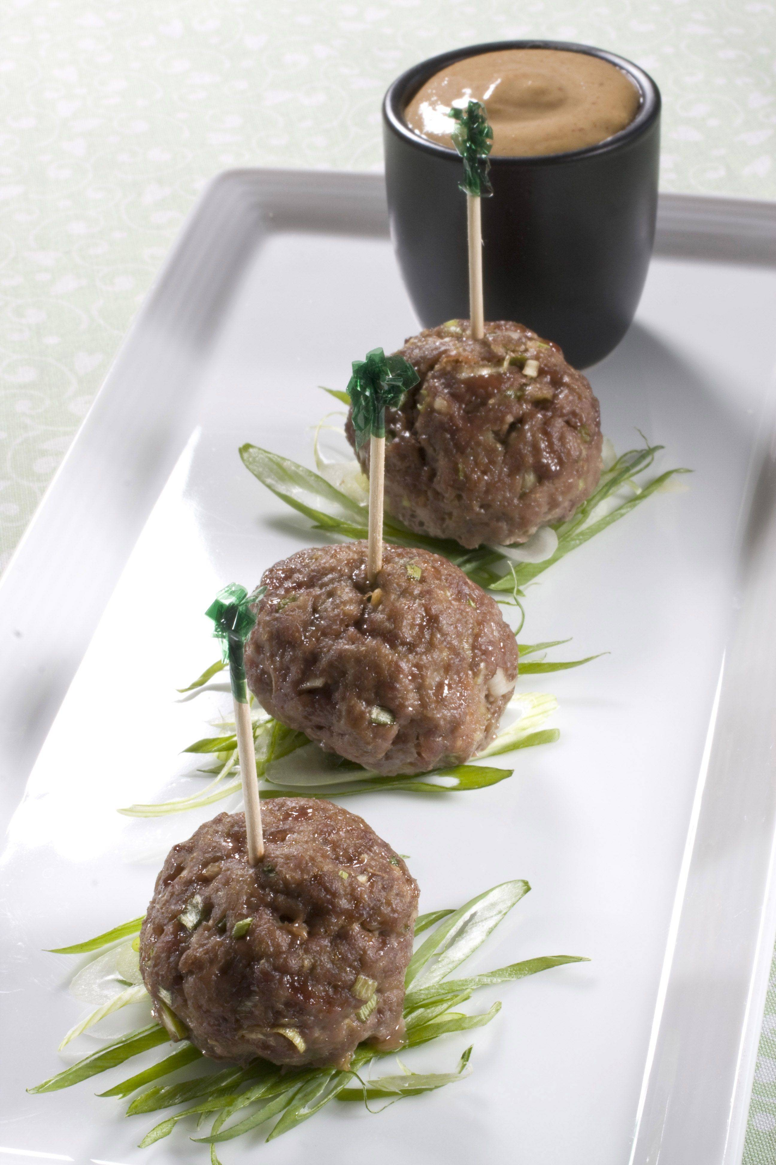 Miso-ginger meatballs with spicy peanut dipping sauce are adaptable to your serving or taste preferences. They also make great burgers and can be made from a variety of different meats.