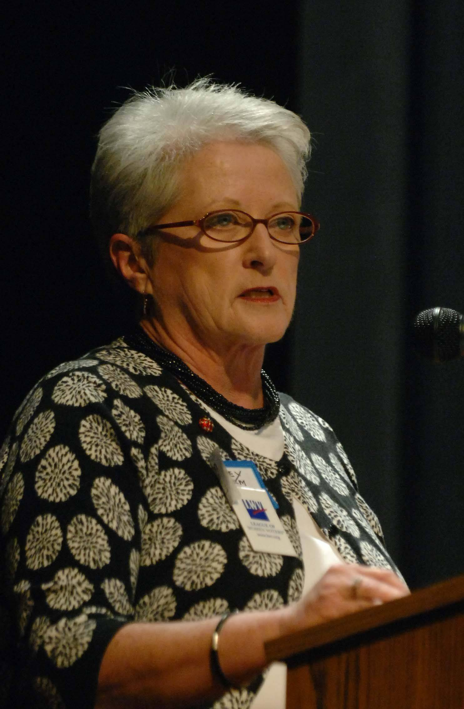 Missey Wilhelm, president of the League of Women Voters of Wheaton, makes introductions during a candidate forum last week at the Wheaton Community Center.