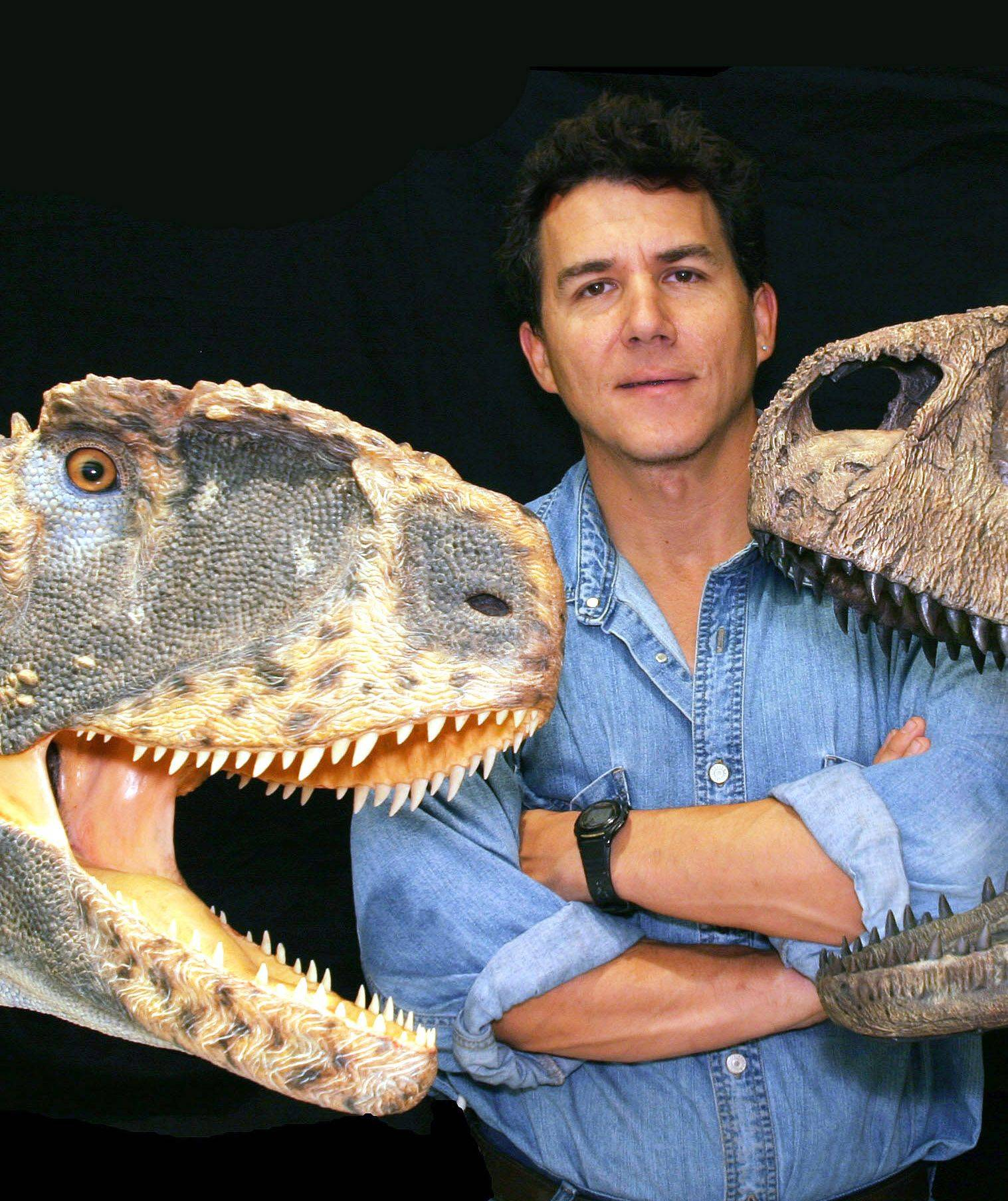 Dr. Paul Sereno holds a skull and reconstructed head of Rugops, one of his dinosaur discoveries, an 8-foot-tall beast with tiny arms that probably were useless for defense.