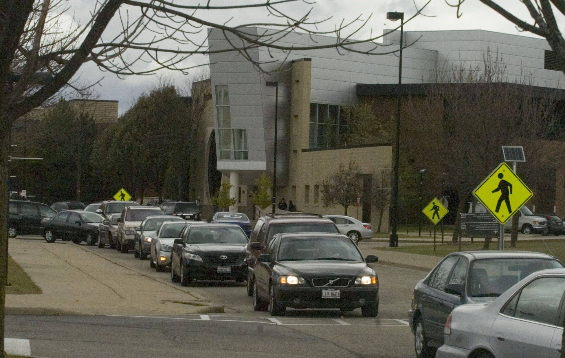 Students and faculty at Elgin Community College sit in traffic Tuesday morning after classes were canceled because of the loss of electricity.