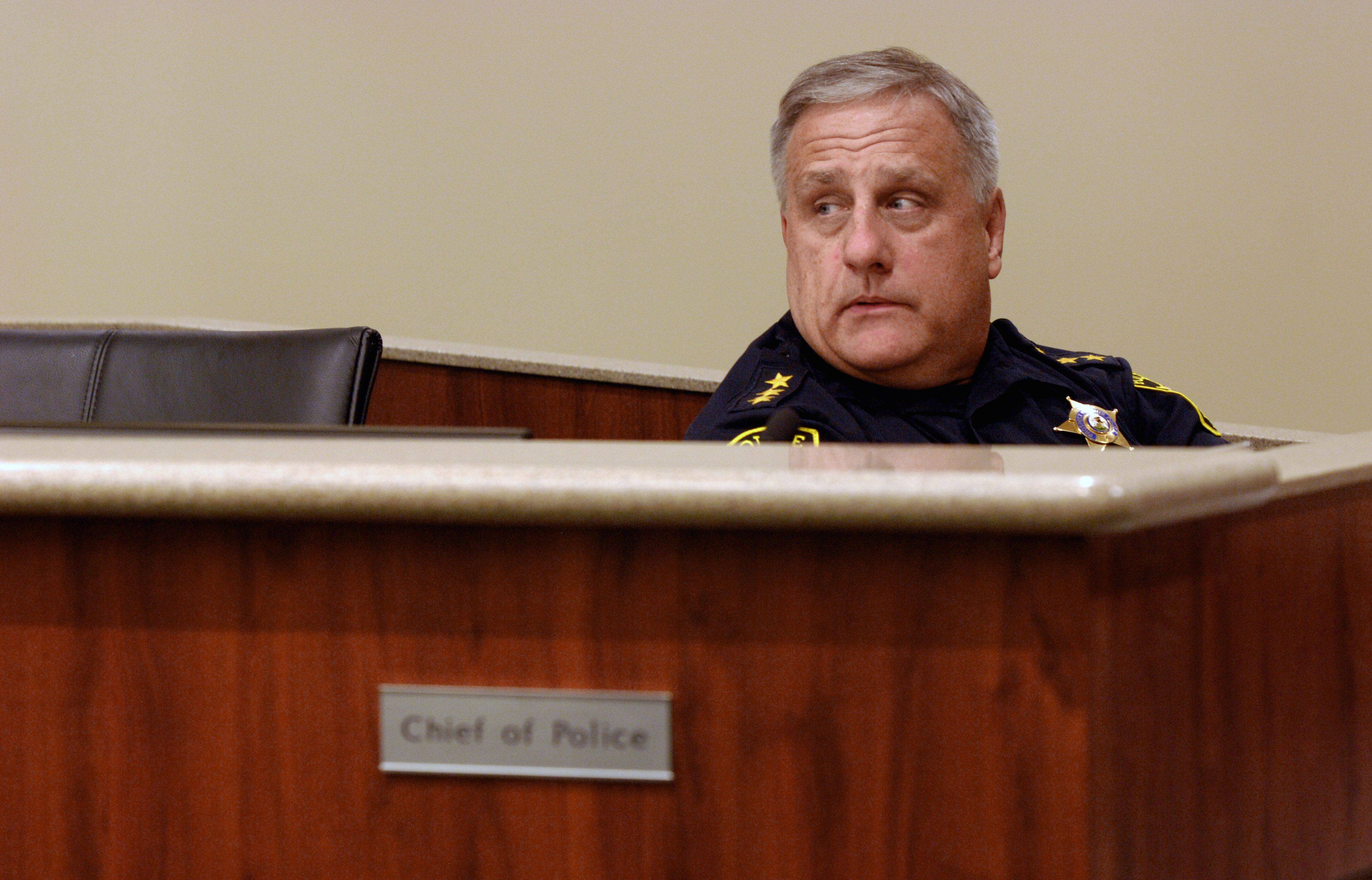 Former Prospect Heights Police Chief Bruce Morris waits for the city council to come out of a closed session discussion about possible police layoffs on Monday night. Morris abruptly resigned Wednesday afternoon after 20 years on the force, 12 as chief.