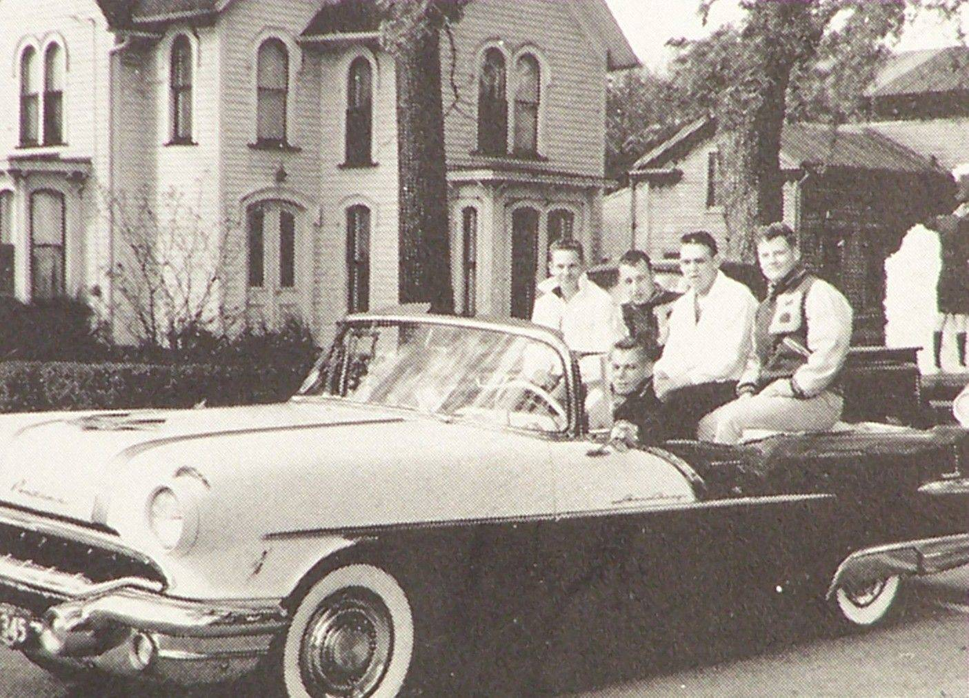 Batavia High School football players ride in a Pontiac convertible in the 1959 homecoming parade.