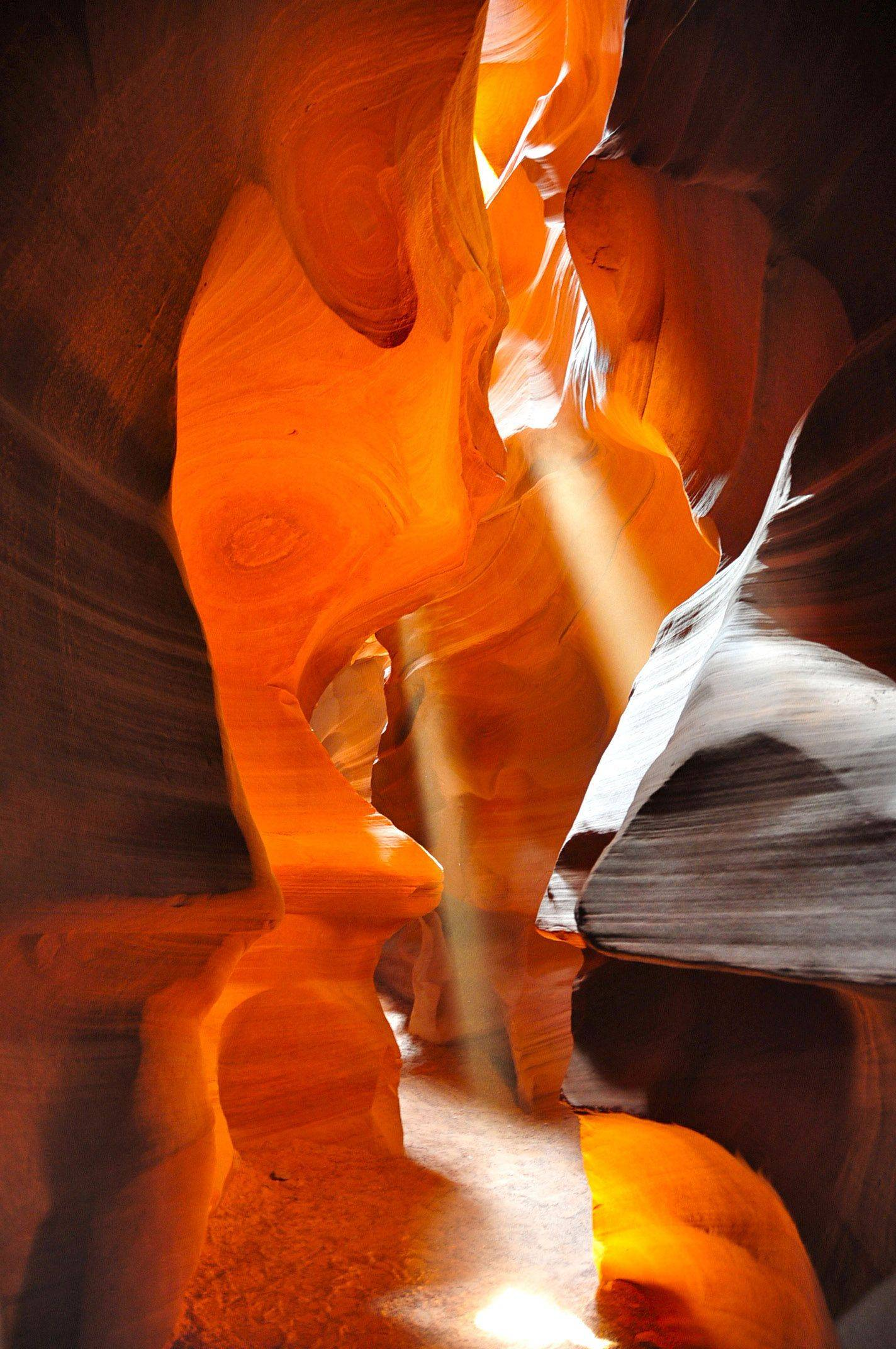 Sunlight streams down the canyon at Upper Antelope Canyon outside Page, AZ.