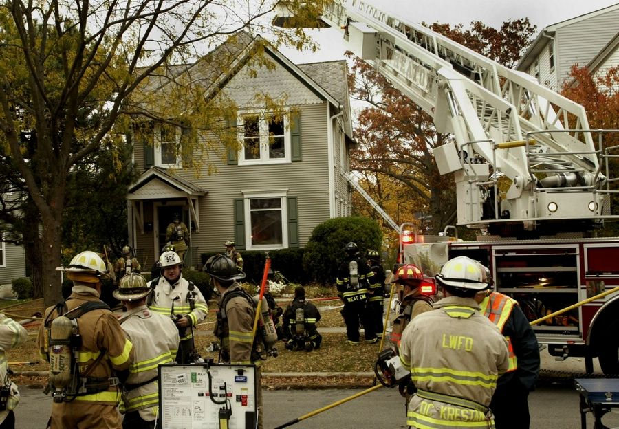 Wheaton firefighters battle a blaze Thursday in an apartment building in the 400 block of South Wheaton Avenue.